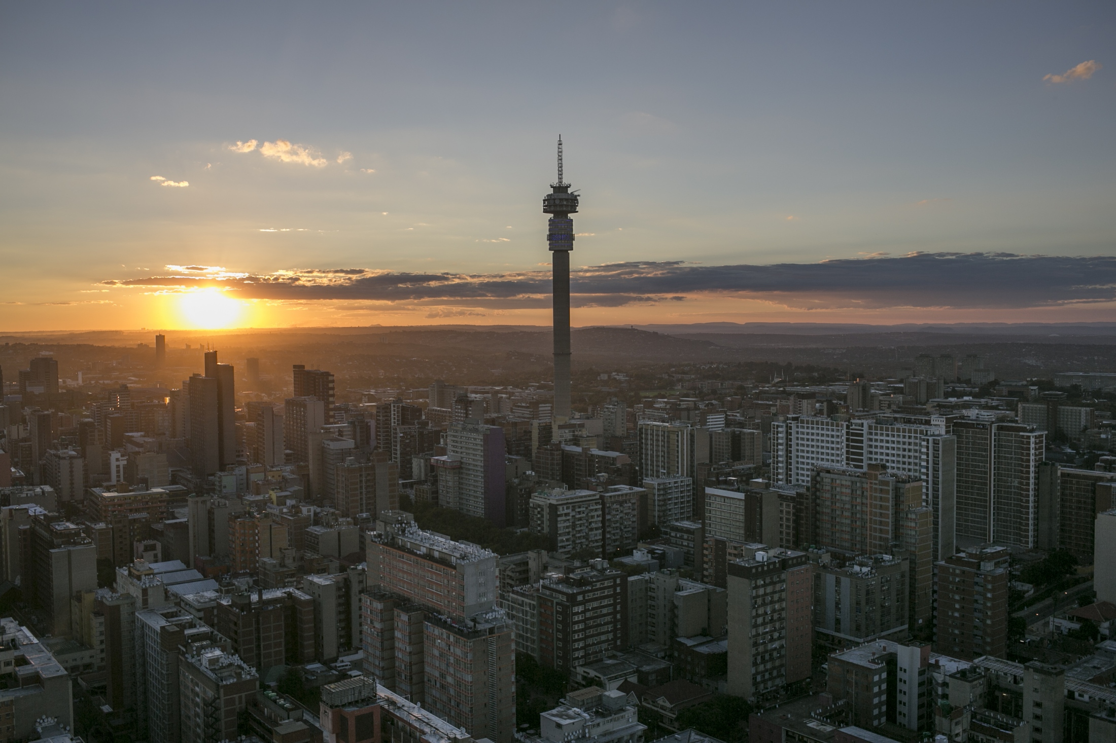 "In this Friday, April 6, 2018 photo, Johannesburg downtown is seen from above. Millions of migrants jostle for work in the thriving underground economy of Gauteng province, whose name roughly translates to ""land of gold."" Thousands of them die without identities or simply disappeared during their journey."