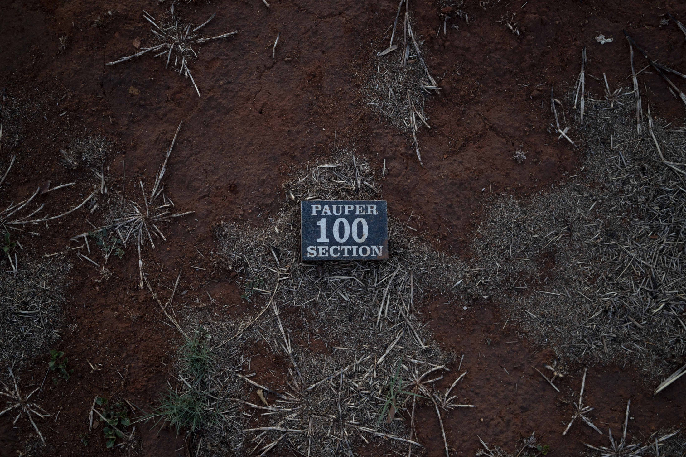 """In this Wednesday, Oct. 3, 2018 photo, a so called """"pauper grave"""" is seen at the Olifantsvlei cemetery outside Johannesburg. At least five bodies of unidentified people are buried in each grave."""
