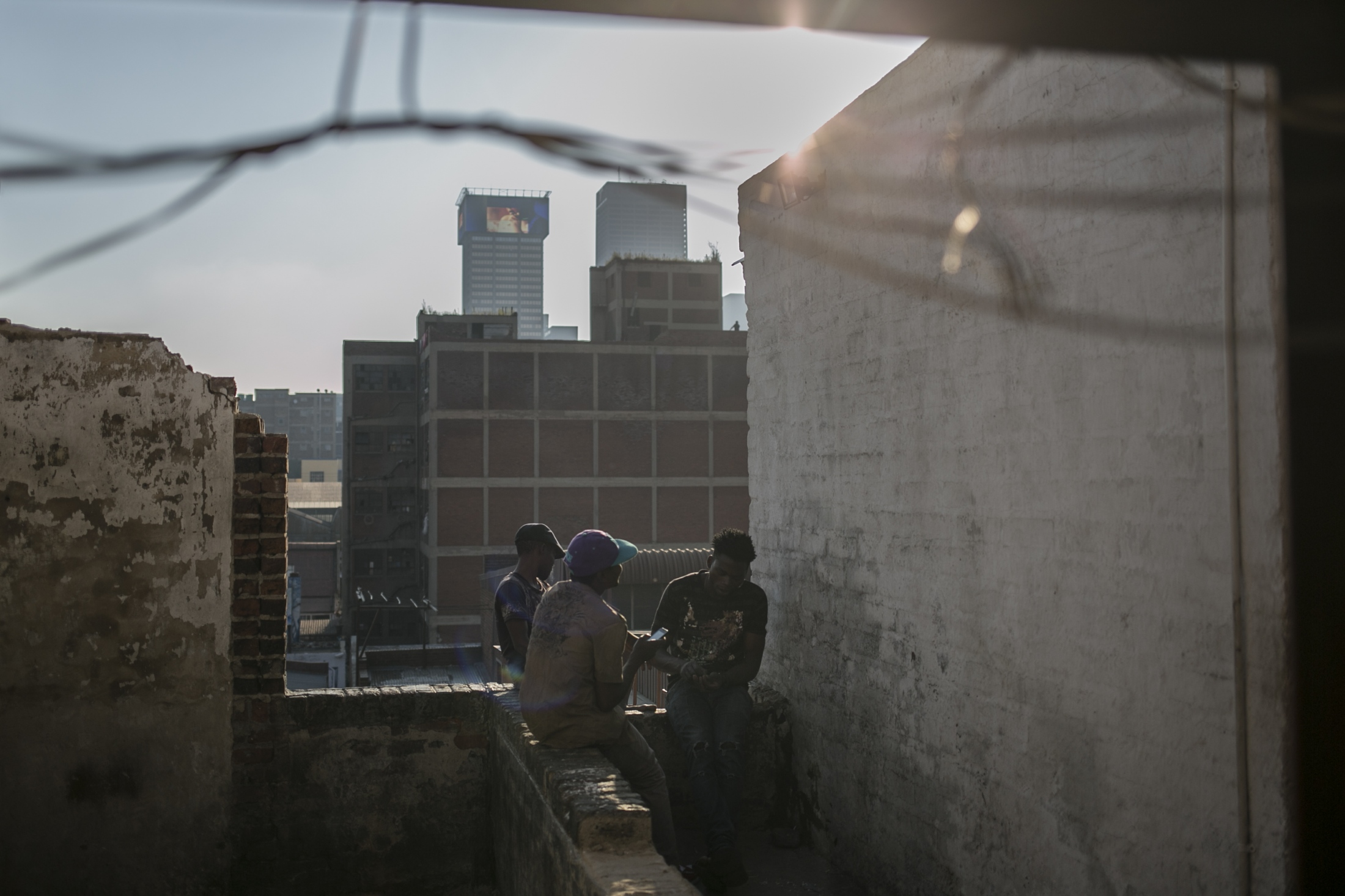 Malawian migrants sit on the rooftop of an abandoned building. March 29, 2018.