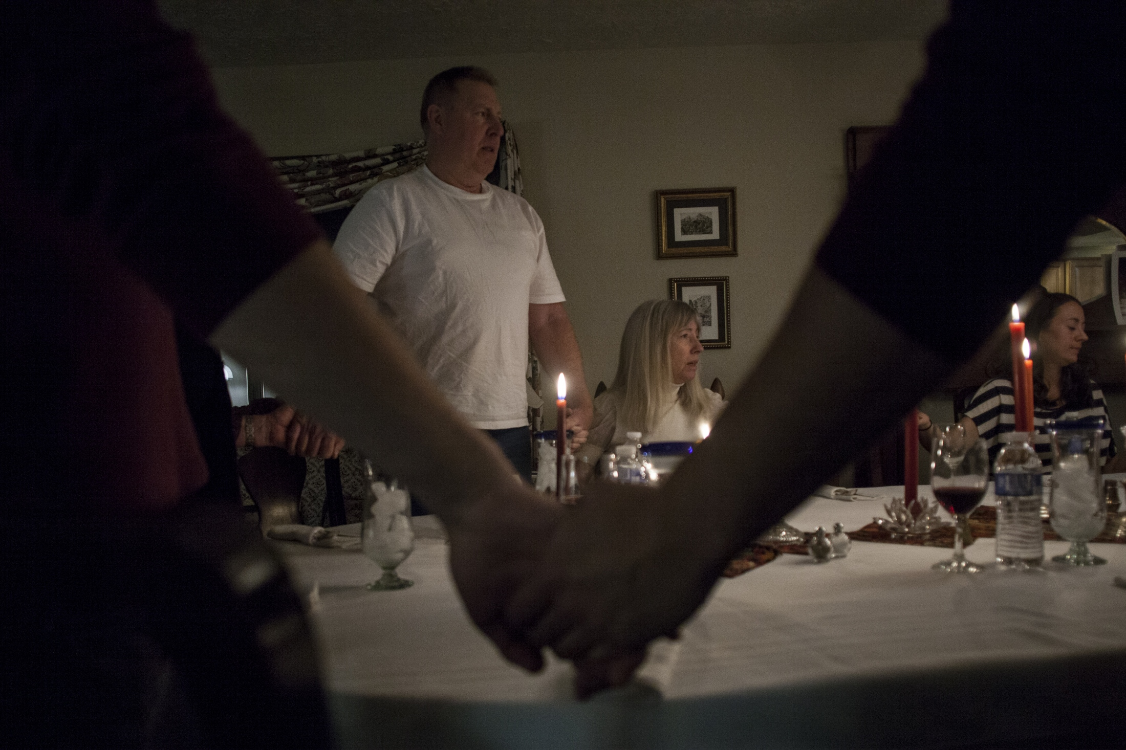 Nancy and her husband, Bill, hold hands in prayer at Thanksgiving dinner in November of 2013. The family still continued to include Nancy in normal family gatherings and routine errands until she became too difficult to take out in public as she would sometimes throw food at the table or inappropriately approach strangers.