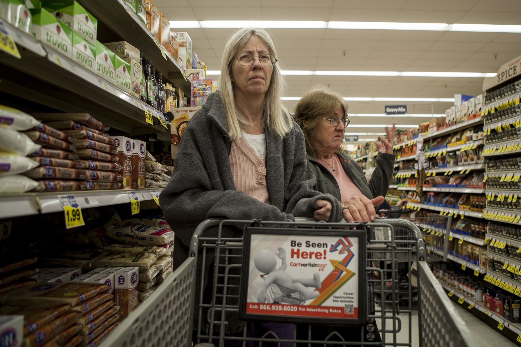 Nancy stares at the other people in the grocery store isle as her sister, Debbie Lundin, shops for food. Outings with Nancy were a regular routine until she became harder to handle in public settings. Often times, she will become very frustrated or wander off talking to strangers angrily.
