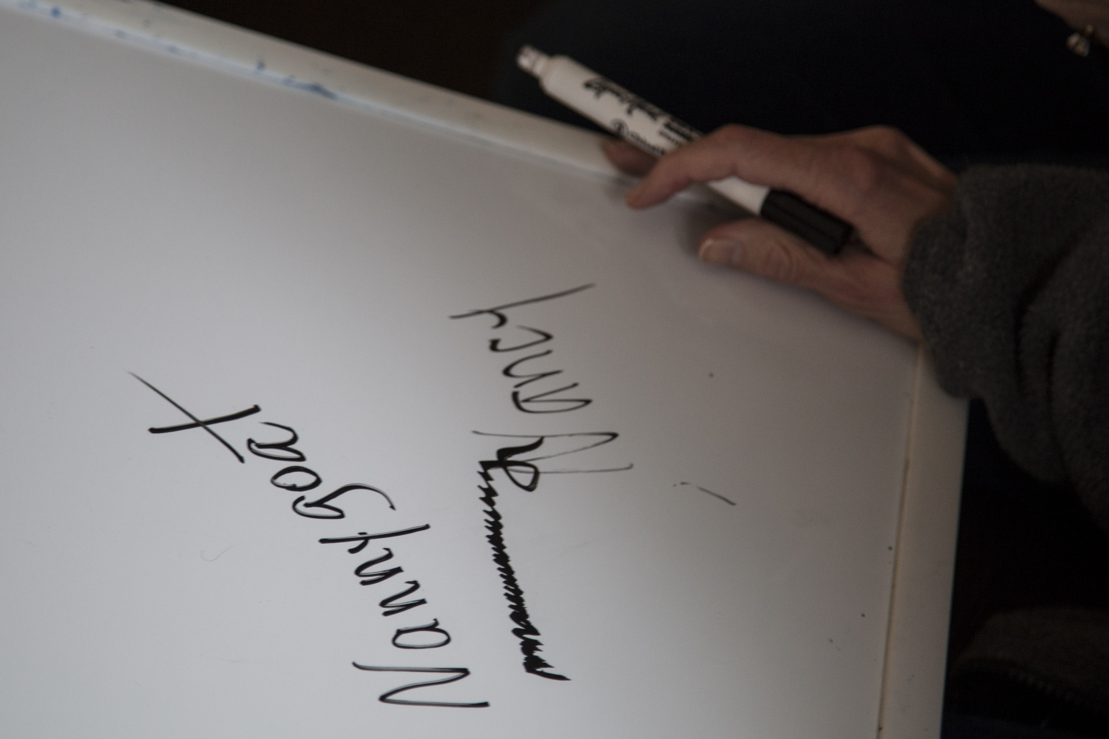 """Nancy's nickname """"Nannygoat"""" is written out on a dry erase board that hangs in her room. Below is how Nancy wrote her name when her sister Cindy asked her to spell it out."""
