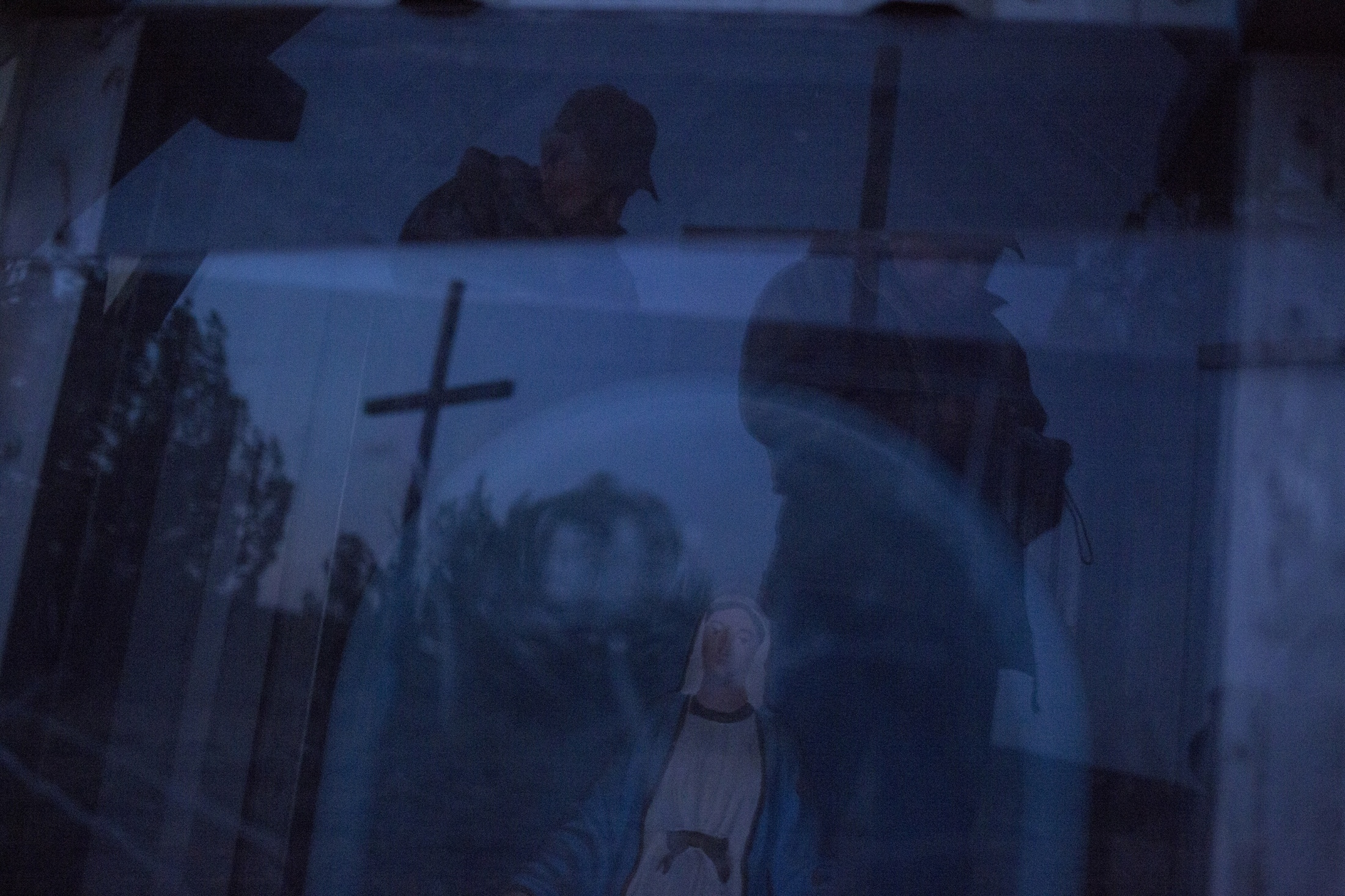 George Gonzales prays at a small chapel atop a hill after he carried a heavy wooden cross for several miles to a peaceful spot on his property south of Santa Rosa. He practices the annual Lenten ritual in the days leading up the the Easter holiday. The majority of residents were raised practicing Catholicism though other denominations have churches in the town.