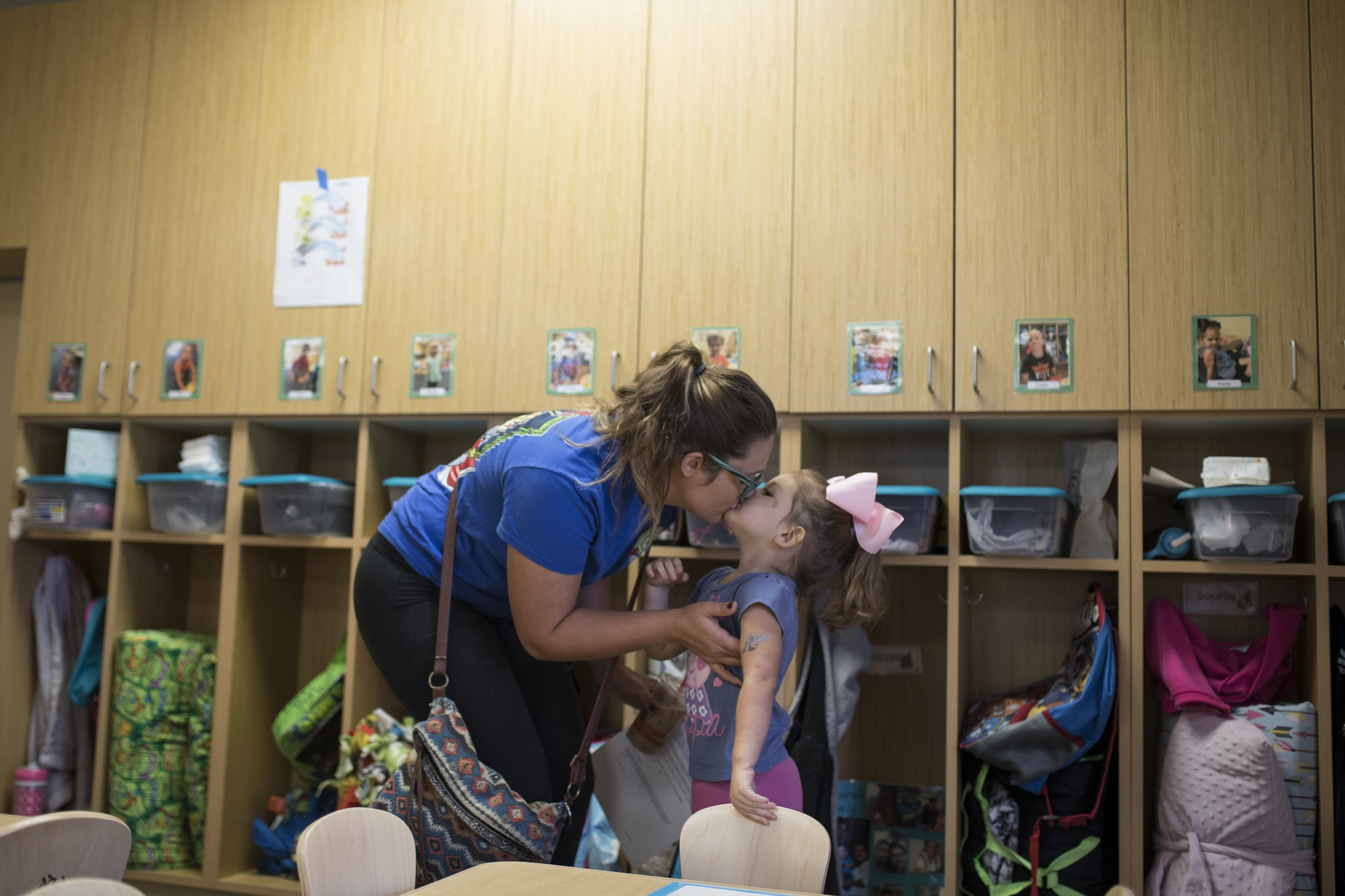 Haylee Carter kisses her daughter, Sophie Patterson, as she drops her off at her daycare class. Carter is a part time employee at the Hagy Center for Young Children and is a student at Amarillo College studying early childhood education. The daycare facility gives a break to students with children to make it affordable for families who are pursuing higher education.