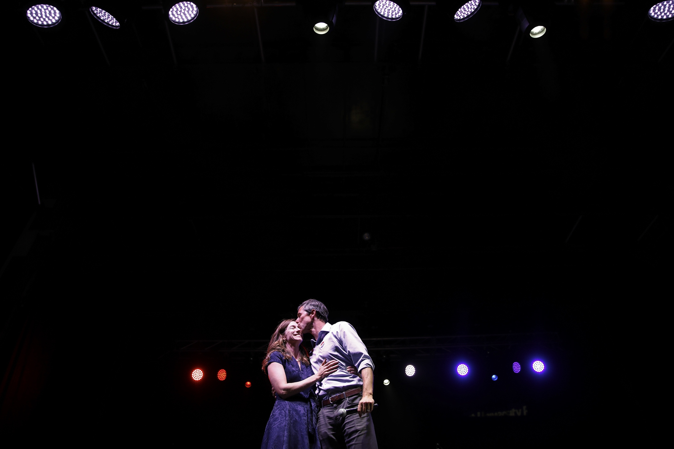 Beto O'Rourke kisses his wife before delivering his concession speech after being defeated by republican Senator Ted Cruz in the high contentious midterm election for a Texas senate seat. O'Rourke is one of the most popular democrats to run in Texas in years as a senate seat hasn't been held by a democrat since 1988. The midterm voter turnout was the highest it's been in decades with 53% of registered voters casting ballots.