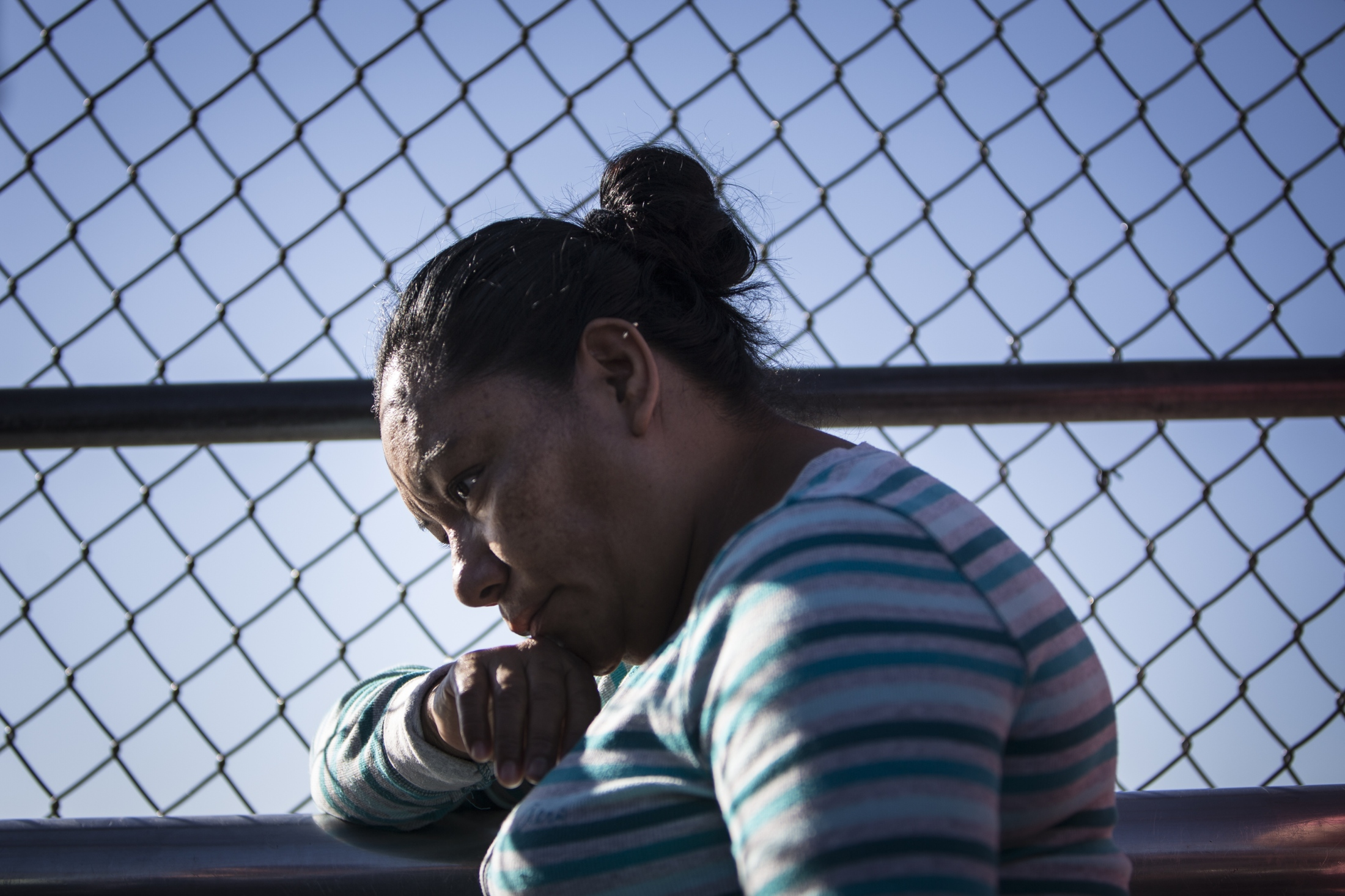 Angelica of Michoacán waits at the El Paso del Norte Port of Entry at the international boundary line to cross into the United States to seek asylum for her and her grandchild on June 20, 2018. they along with a family of five were assisted by the Annunciation House, a migrant aid agency that runs a shelter in El Paso, Texas, on June 20, 2018.