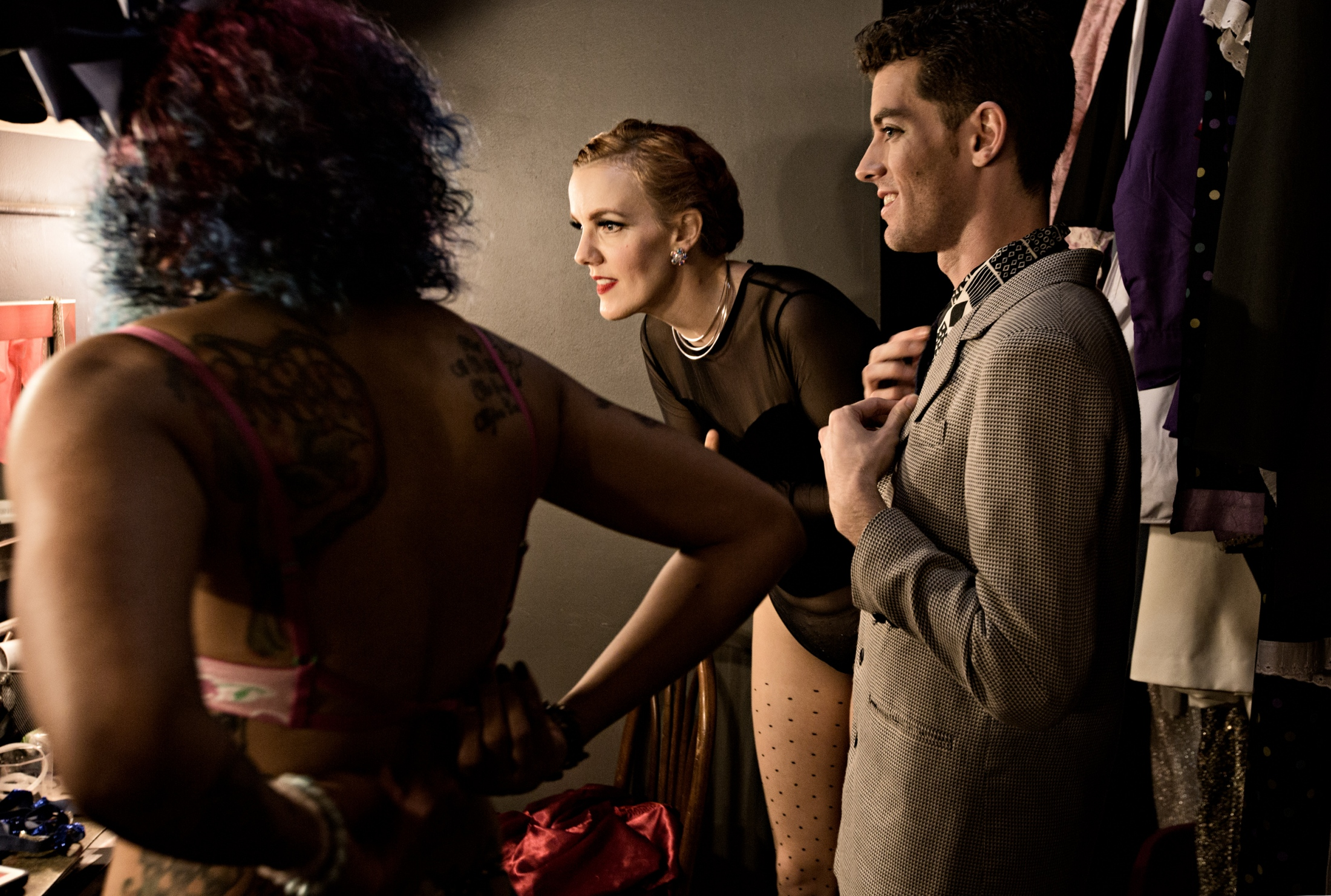 Zara Estelle, Red Hot Annie and Dirty Devlin check each others' outfit and makeup before their performance. There are a lot of lighthearted moments backstage and Vaudezilla members joke with one another. Laughter and good-nature chatter is a generally part of the background noise as the members prepare to take the stage.