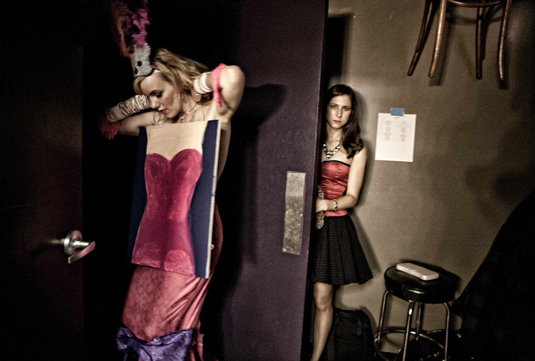 Stagehand Aurora S'more calls Red Hot Annie as she puts final touches on her costume moments before taking the stage. Backstage can appear chaotic, but actually is a well-oiled machine with a fine-tuned order. While standing at the stage entrance, the dancer waits to be introduced by the announcer. The wait gives the dancer an opportunity for a costume check and to mentally prepare to take the stage.