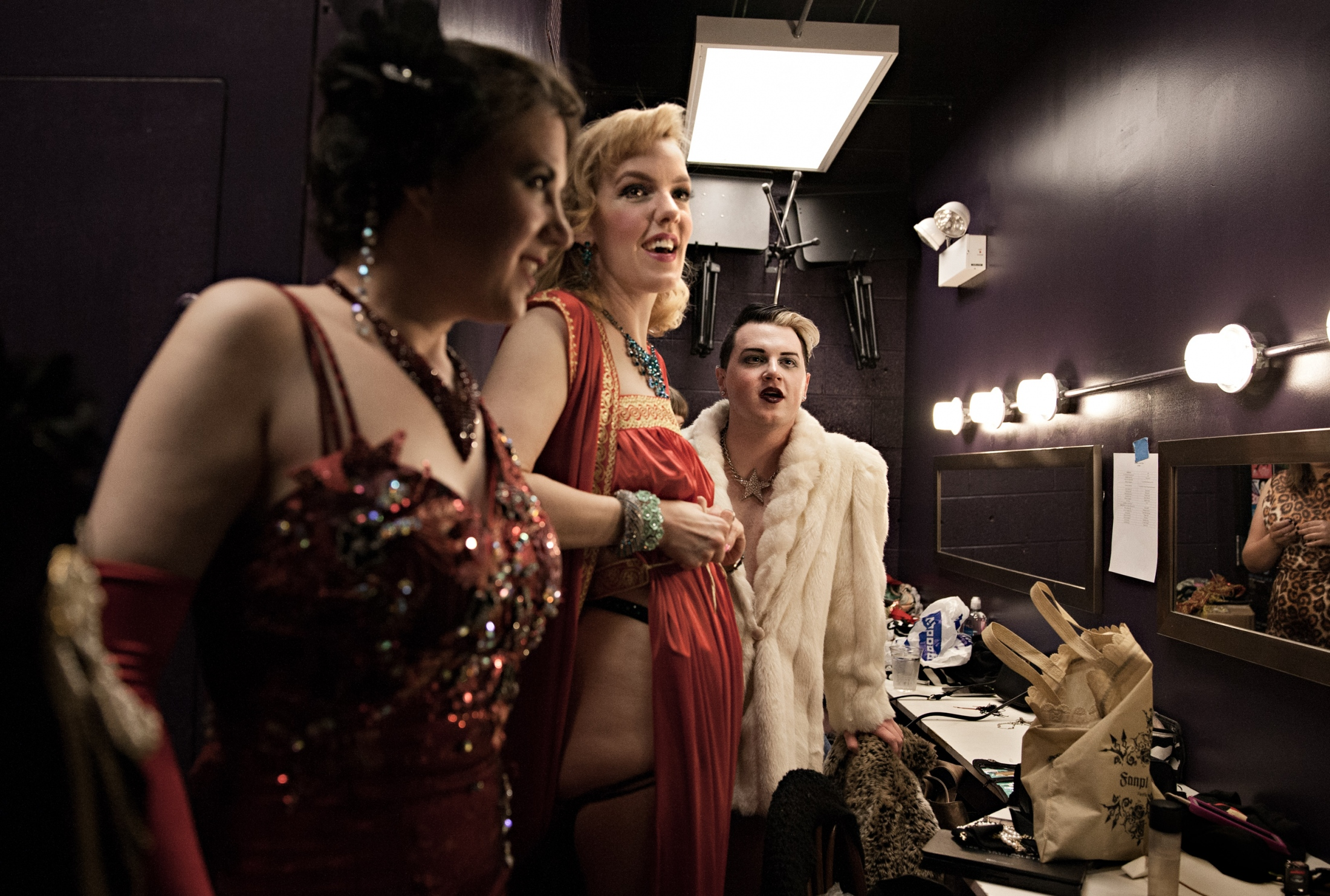 Sadie O'Swirl, Red Hot Annie and Willy LaQueue joke around at the end of a show while getting ready to go home.