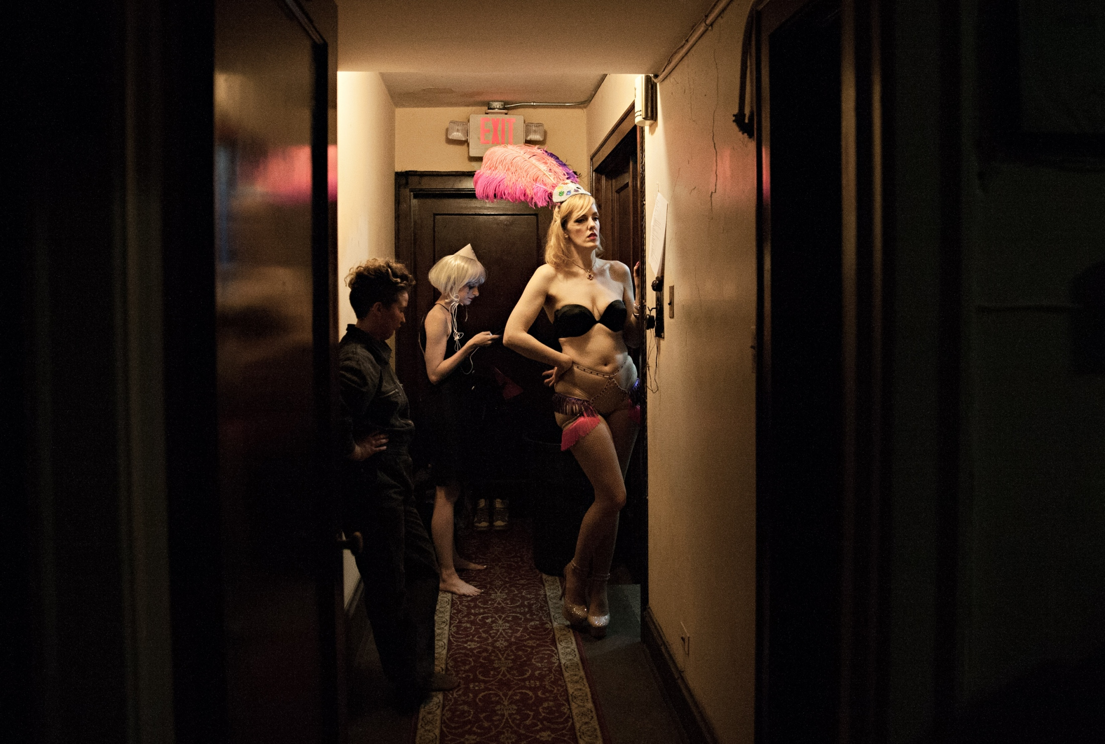 Double Dixen, Lady Jack and Red Hot Annie hang outside the makeup room and wait for their curtain time. The backstage area differs with each venue. Often the space is extremely limited and the members of the troupe have to take turns and squeeze past one another as they prepare to take the stage. The camaraderie that exists between the members of Vaudezilla is palpable - it is obvious that they all genuinely like and support each other.