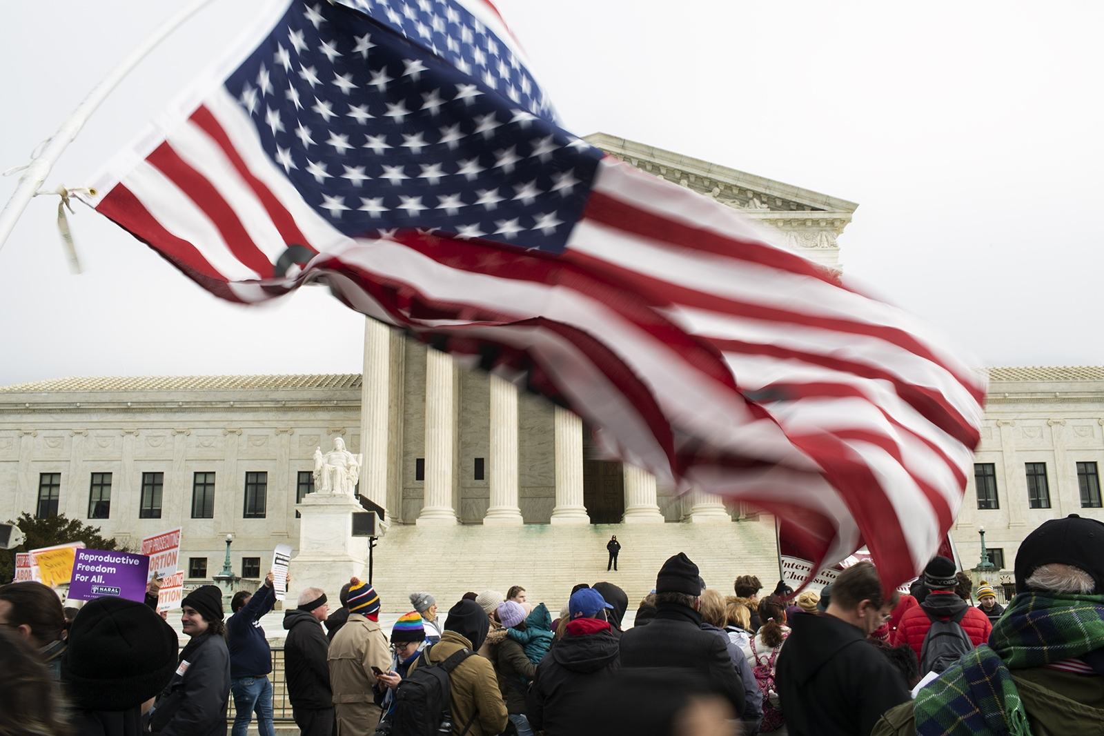 Thousands of people march in front of the U.S. Supreme Court.