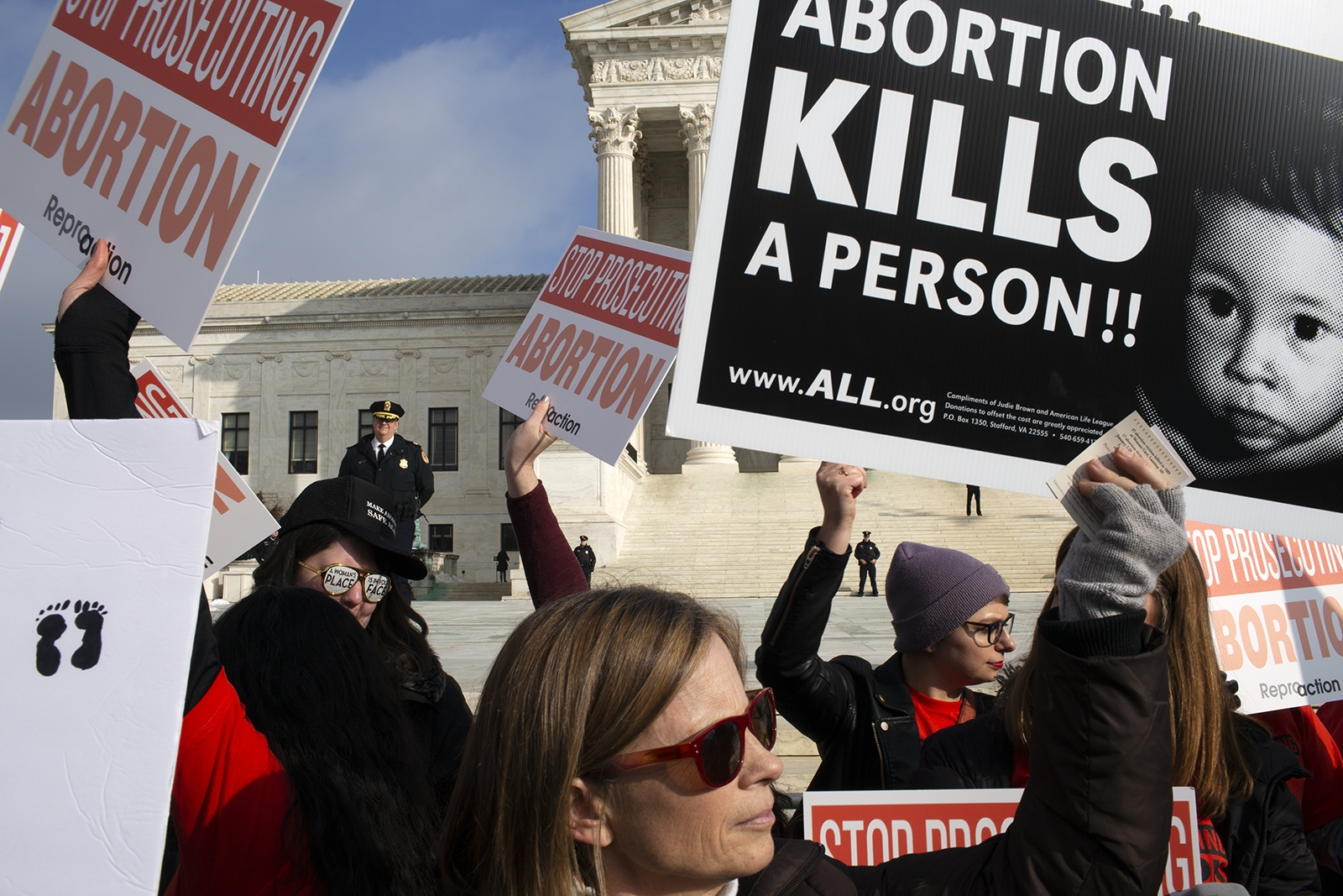 Pro-life and Pro-choice marchers mix on the Supreme Court campus.