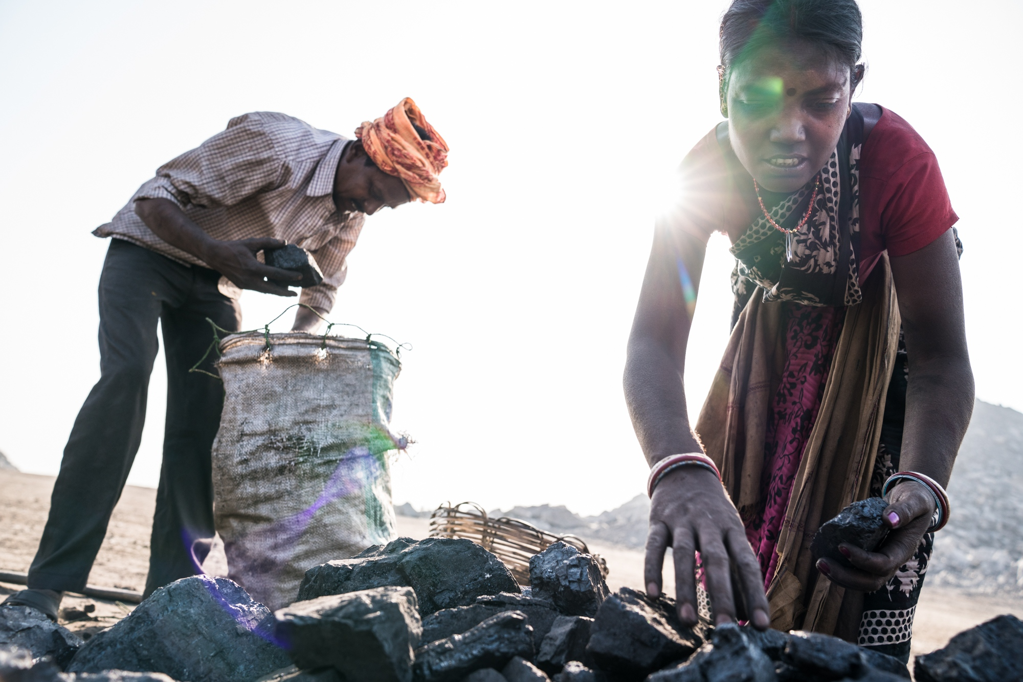 Miners select scavenged coal for sale or to be used personally in their homes as cooking fuel.