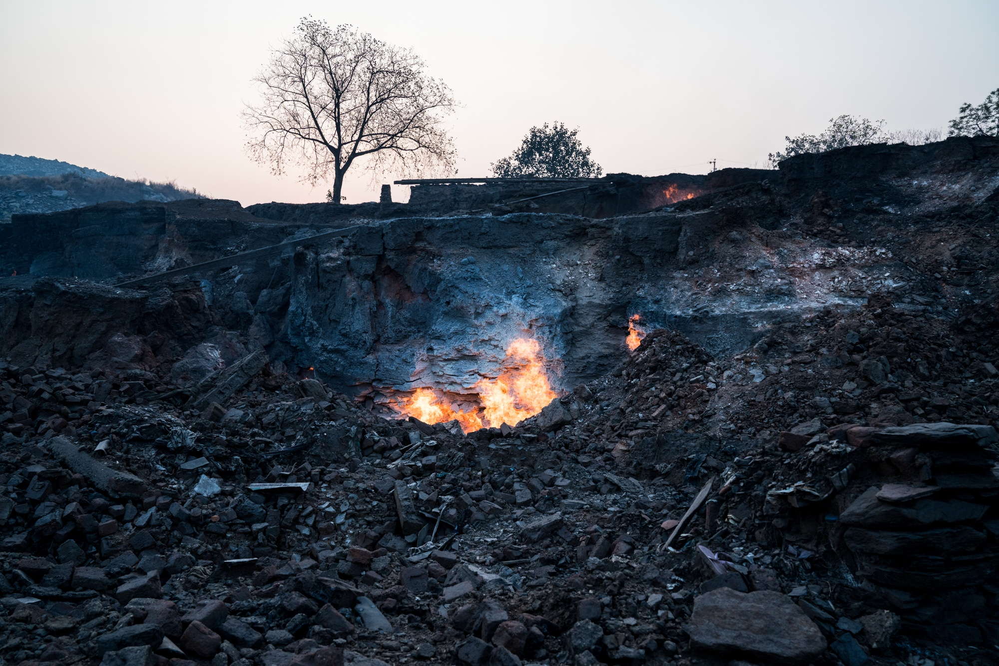 Once a village, it now lays in rubble due to underground fires that have destabilised the land below. Apart from destabilising the land, the fire releases a constant stream of black carbon and other dangerous gases and particulates. India.