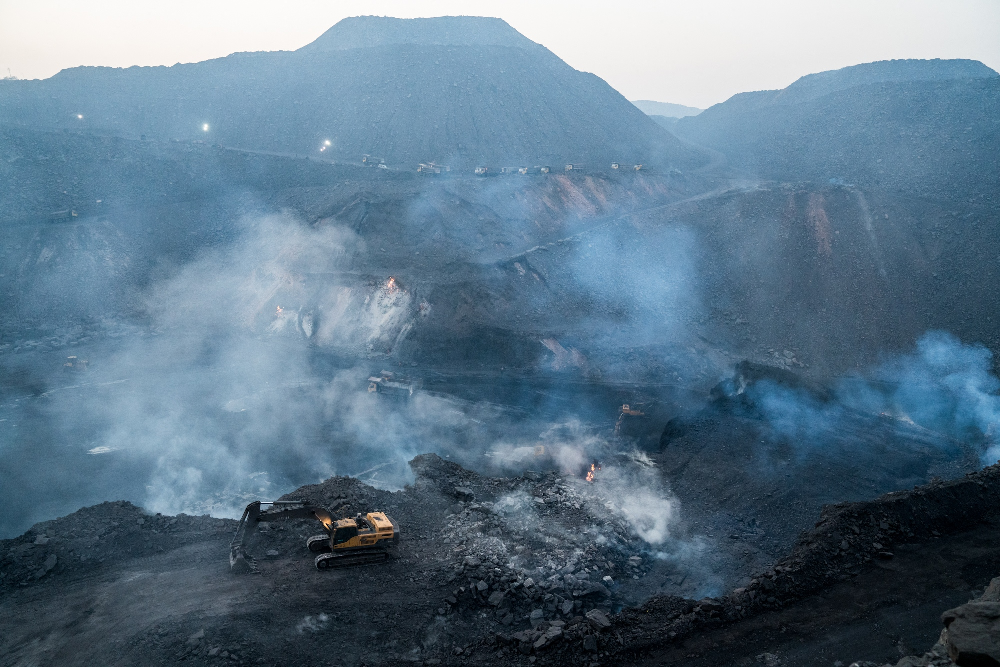Smoke billowing up from the underground coal-fuelled fires in one of India's largest coal mining regions.