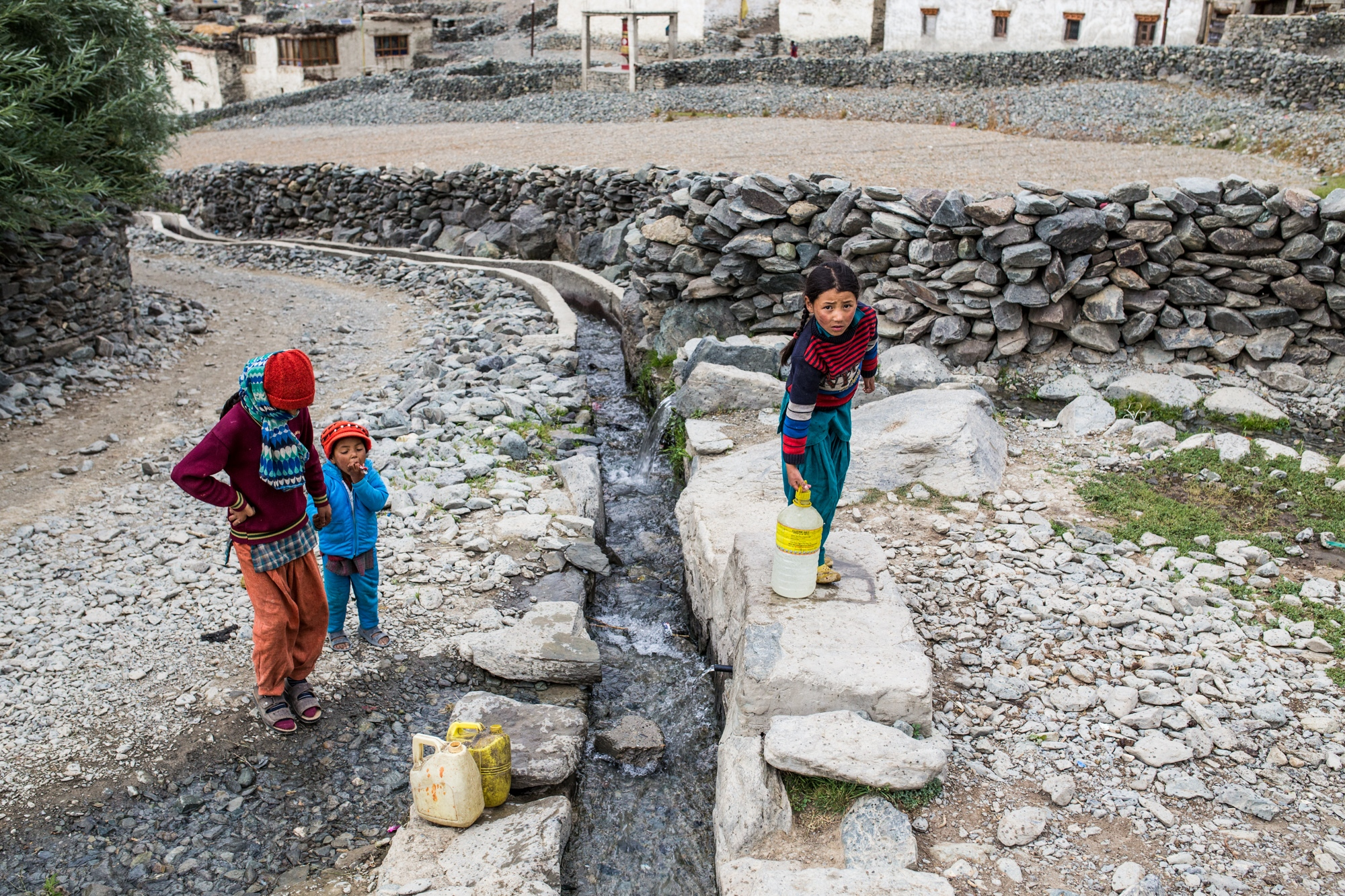 Girls in the Zanskar Himalaya, India, collect water sourced from a spring recharged from winter snow-melt, which is in vast decline due to rising temperatures and black carbon.
