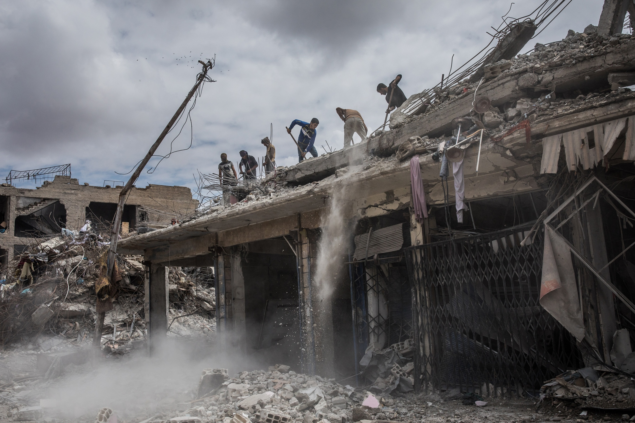 Construction workers remove rubble from a destroyed building in Raqqa, Syria, on Wednesday, May 9, 2018. An estimated 80 percent of Raqqa's infrastructure was destroyed or damaged during the offensive to retake the city from ISIS, with thousands of lives lost in aitstrikes by the coalition, addition to those civilians who were executed by ISIS during their reign over the city from 2014 until their ouster in 2017.