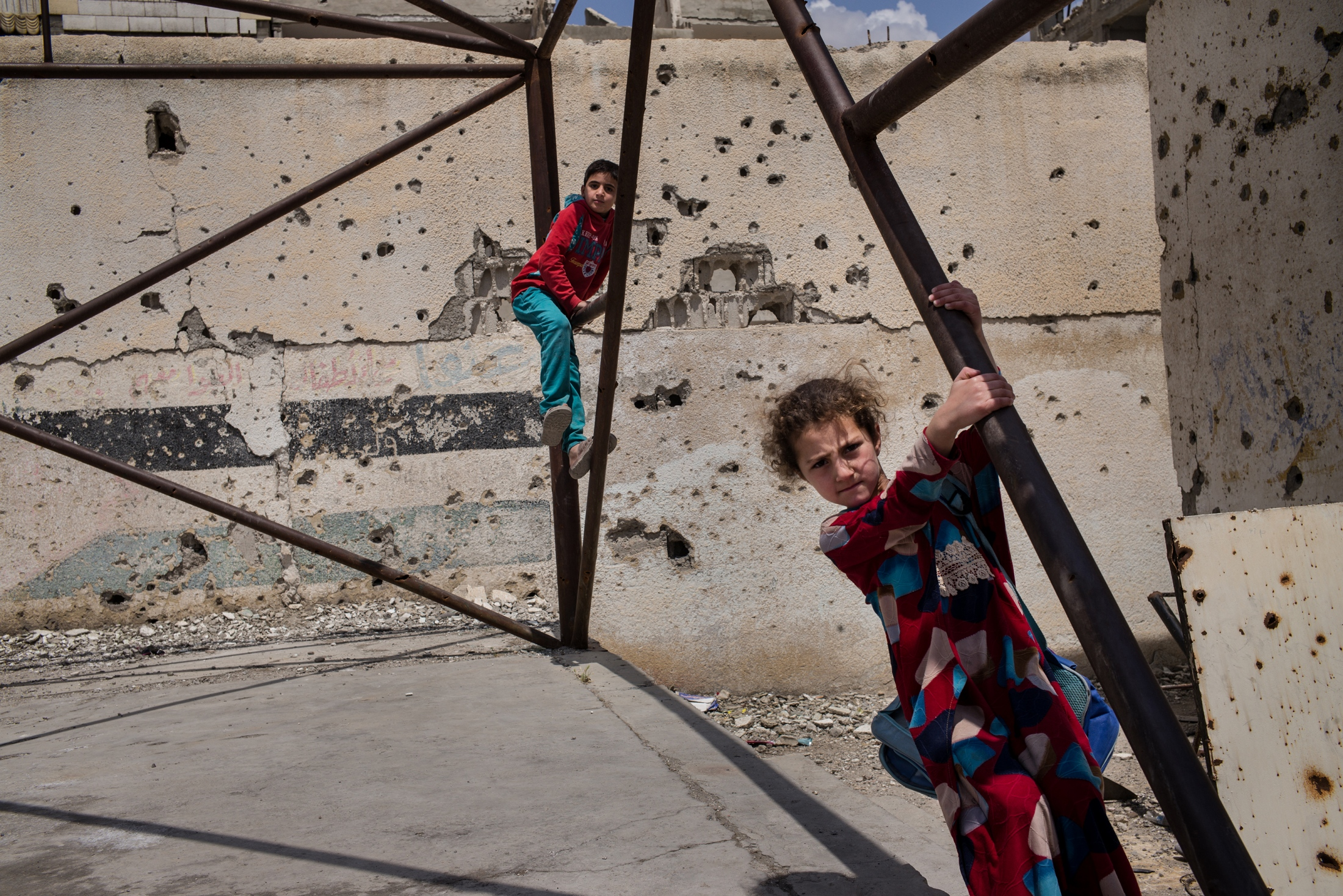 Children play in the courtyard at the heavily damaged Hawari Bu Medyan School, in Raqqa, Syria, on Thursday, May 10, 2018. The school is located opposite a building that was used by ISIS's religious police, the Hisba, and was also the site of intense fighting during the offensive to retake the city from the extremist group. The school reopened in January 2018.