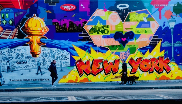 A giant Mural homage to when Keith Haring, Daze and others painted the Houston Bowery wall.