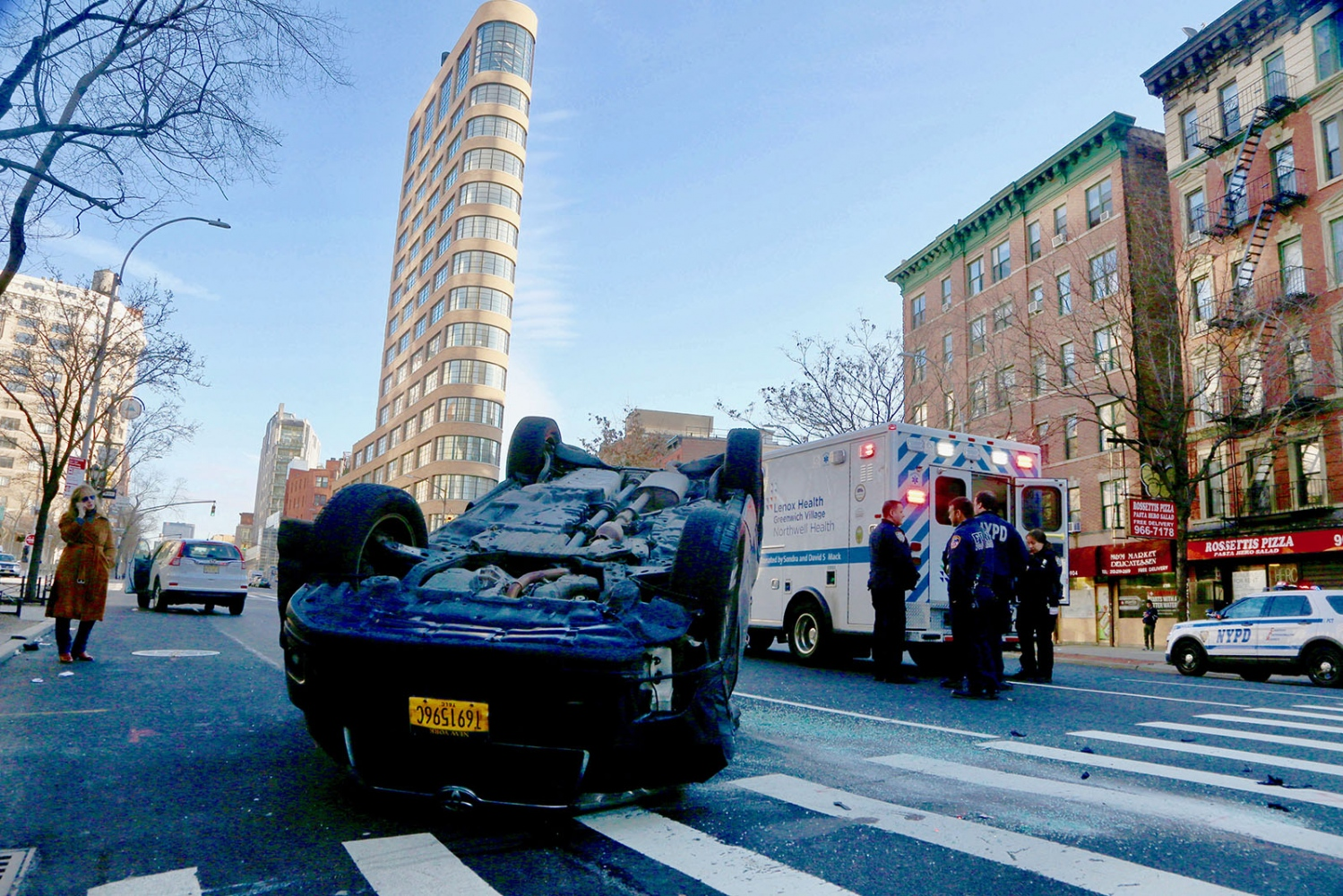 NYPD Officers from the 1st Precinct in downtown Manhattan work on the scene of a two car accident on the corner of Watts Street and Sixth Avenue.