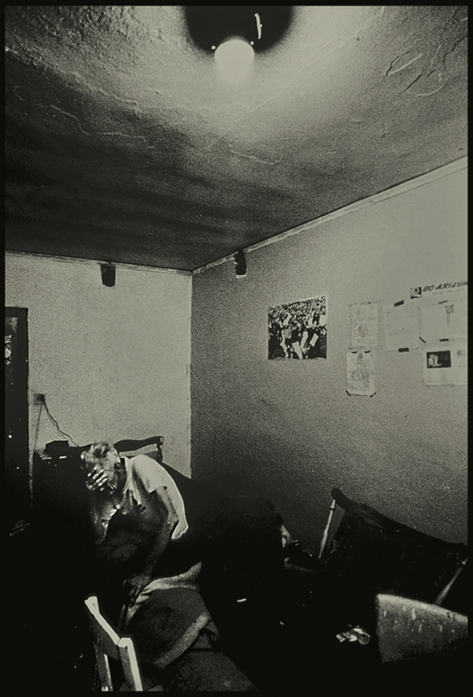 Hopeless, facing eviction from his squatter hotel room, Arizona, USA. 1980s.