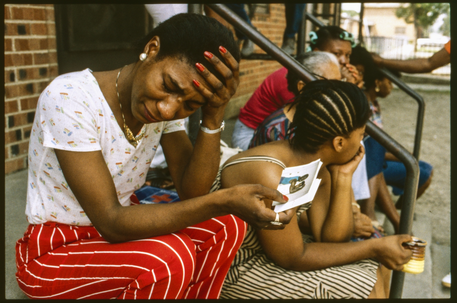 Overcome with grief after her teen daughter was killed in drive-by shooting. Dallas, Texas, USA. 1985.
