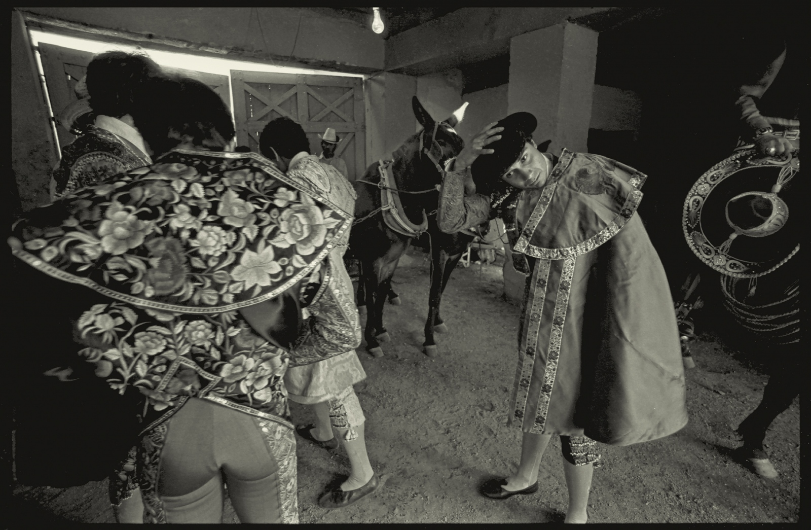 Matadors prepare for bullfight, Nogales, Sonora, Mexico.1980.
