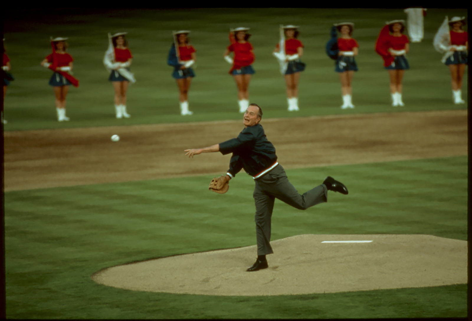 President George H.W. Bush throwing out first pitch of season, Arlington, Texas, USA. 1991.