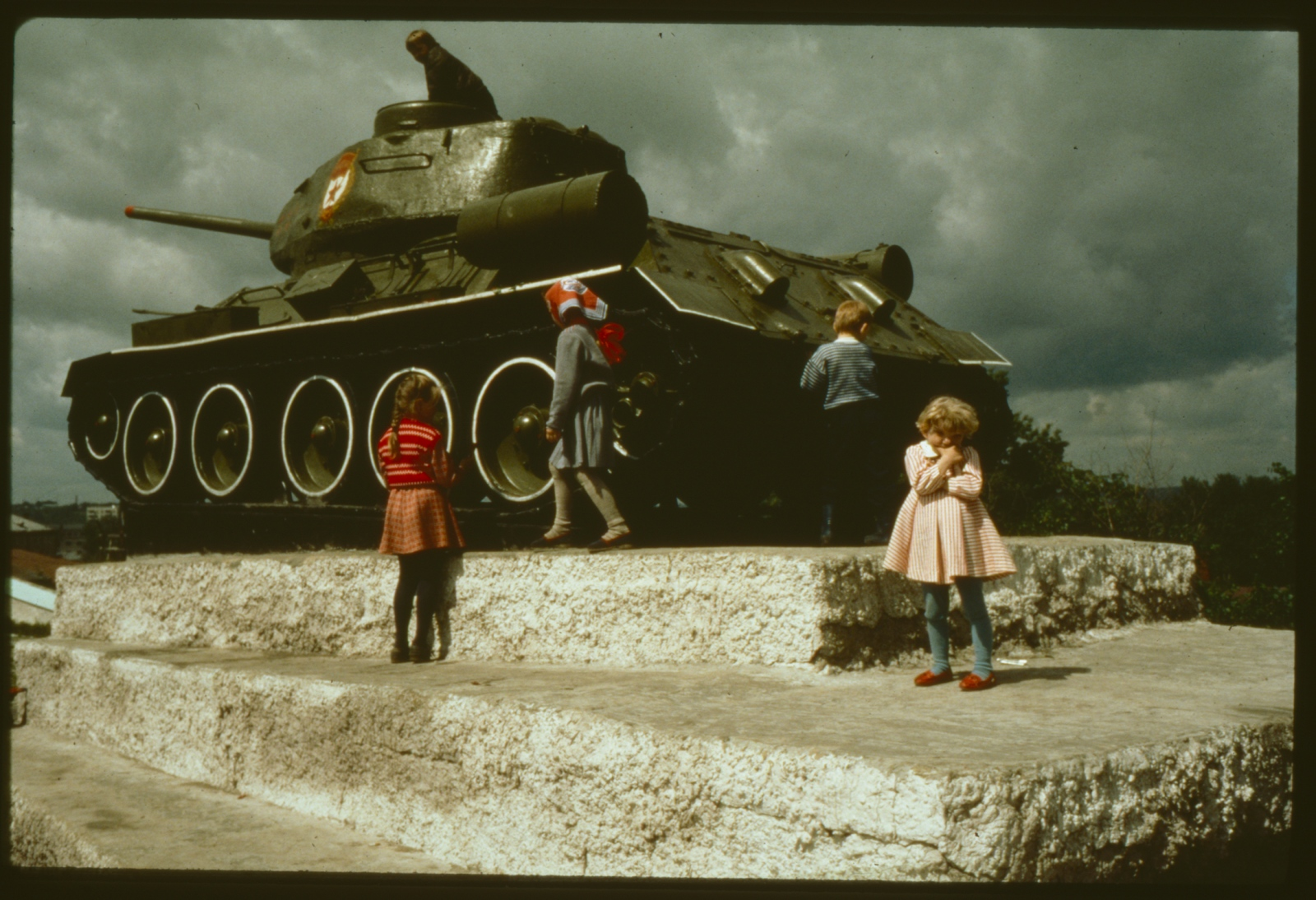 Pouting during playtime on Soviet tank.