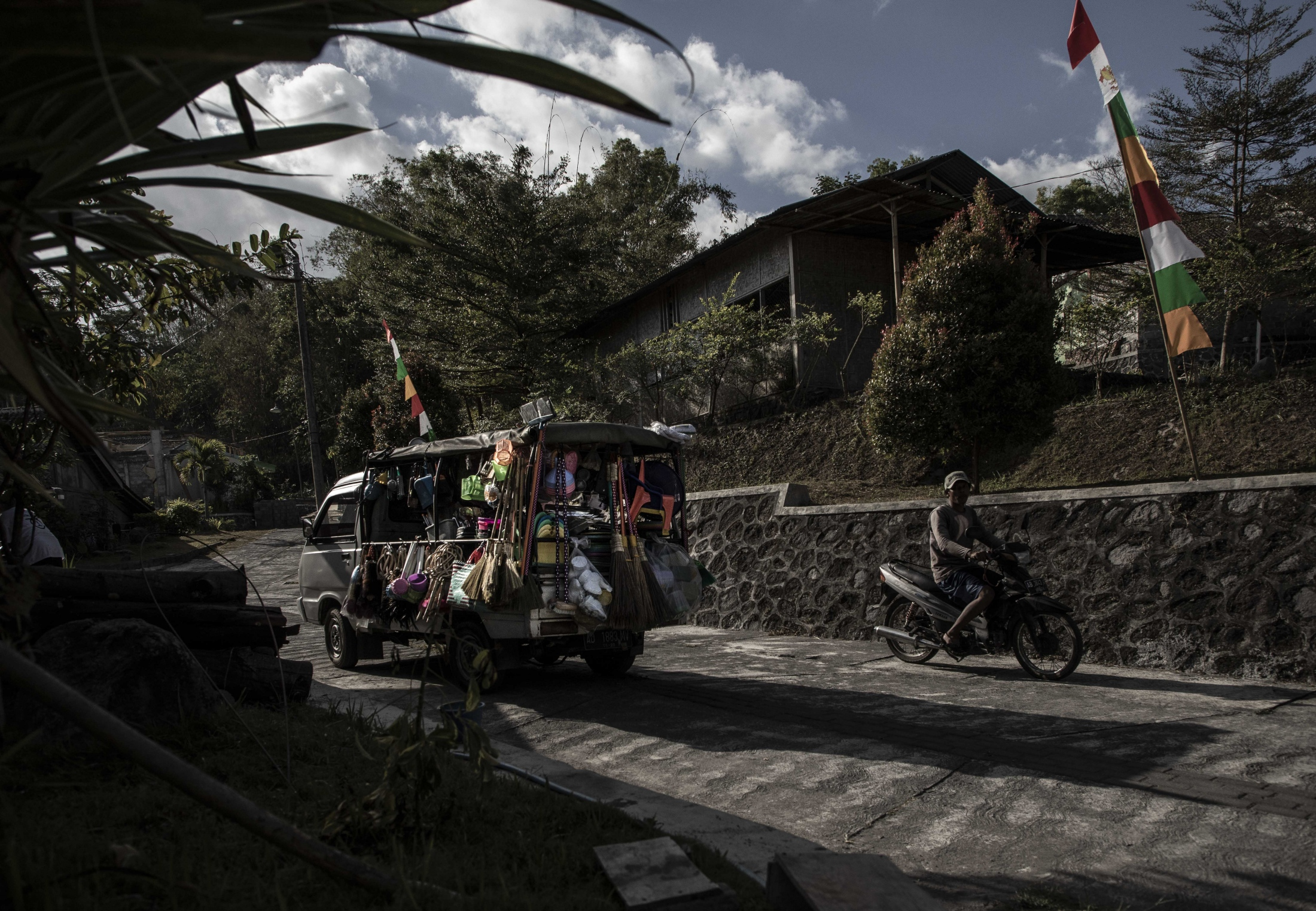 An afternoon street scene Karang Kendal - the few cars that visit the village are usually local sellers of household goods.