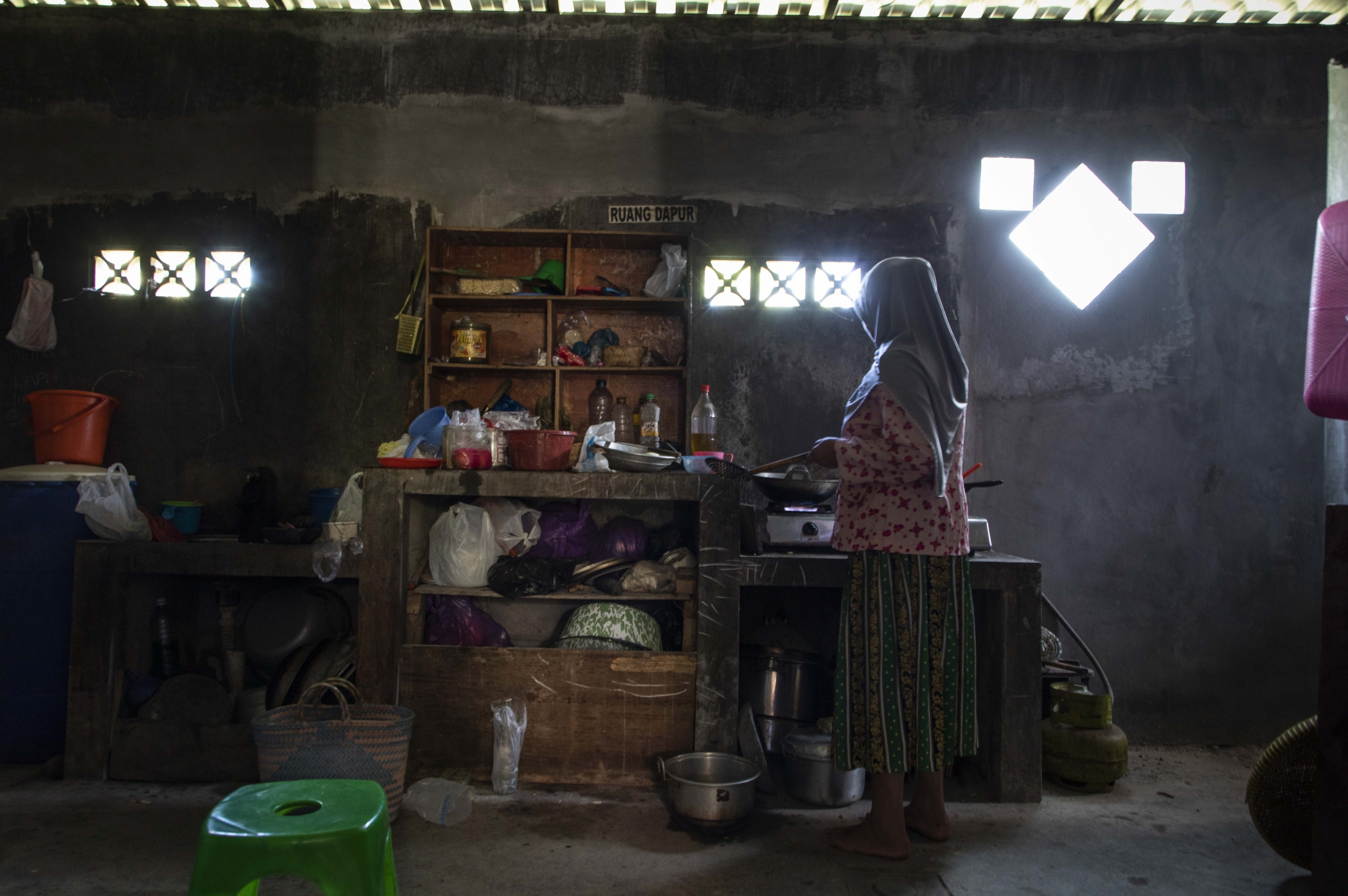 Mbah Parish preparing lunch in her kitchen.