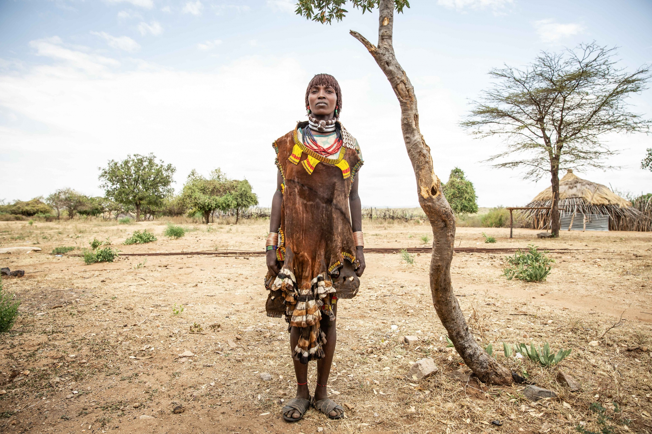 Portrait of Gadi in South Omo region, Ethiopia. As primary care-givers, women are the key to tackling the severe poverty that families in South Omo face, and with the help of Farm Africa's Livestock for Livelihoods project, they can be able to. For Farm Africa.