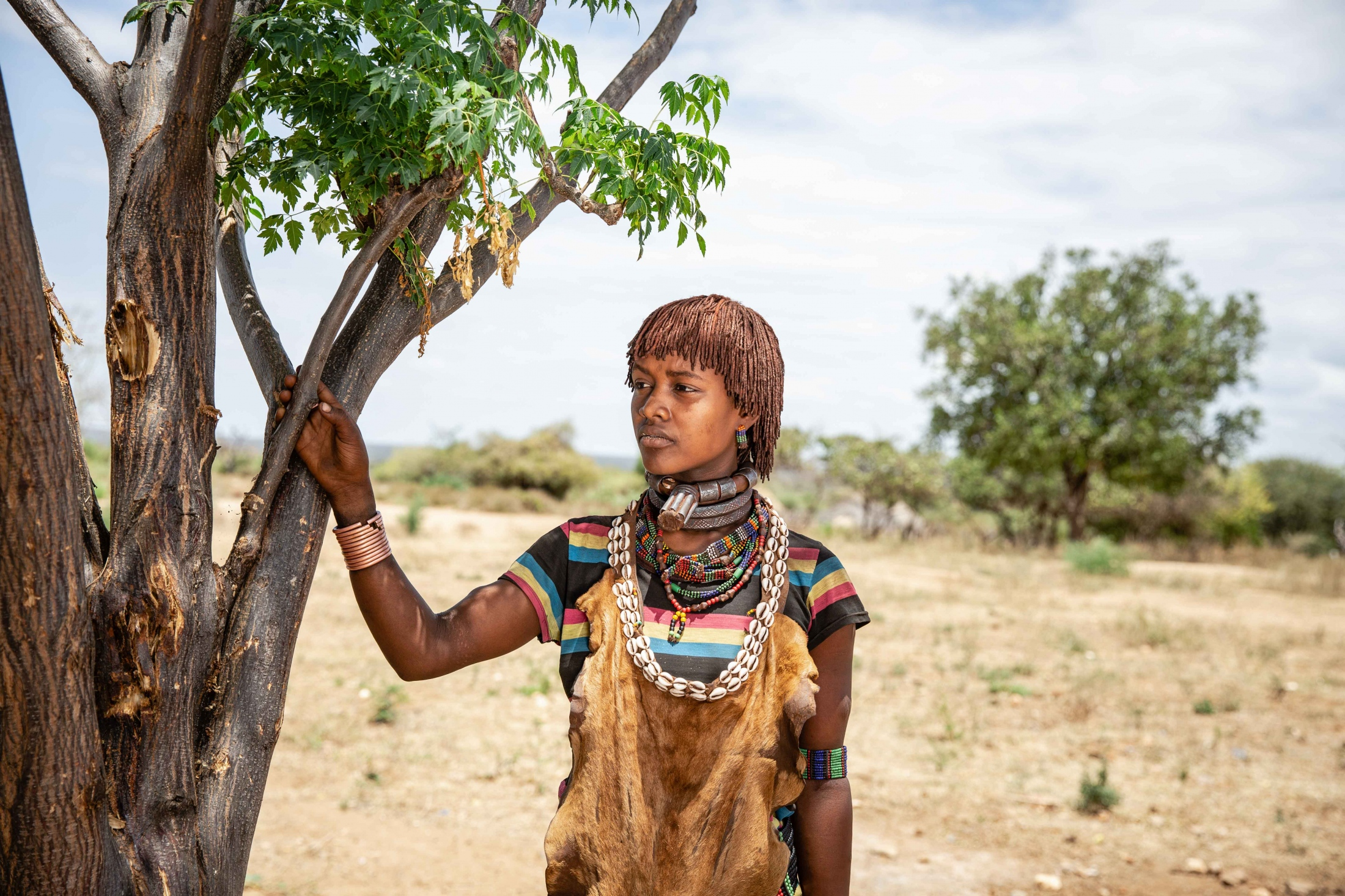Portrait of Awga in South Omo region, Ethiopia. As primary care-givers, women are the key to tackling the severe poverty that families in South Omo face, and with the help of Farm Africa's Livestock for Livelihoods project, they can be able to. For Farm Africa.