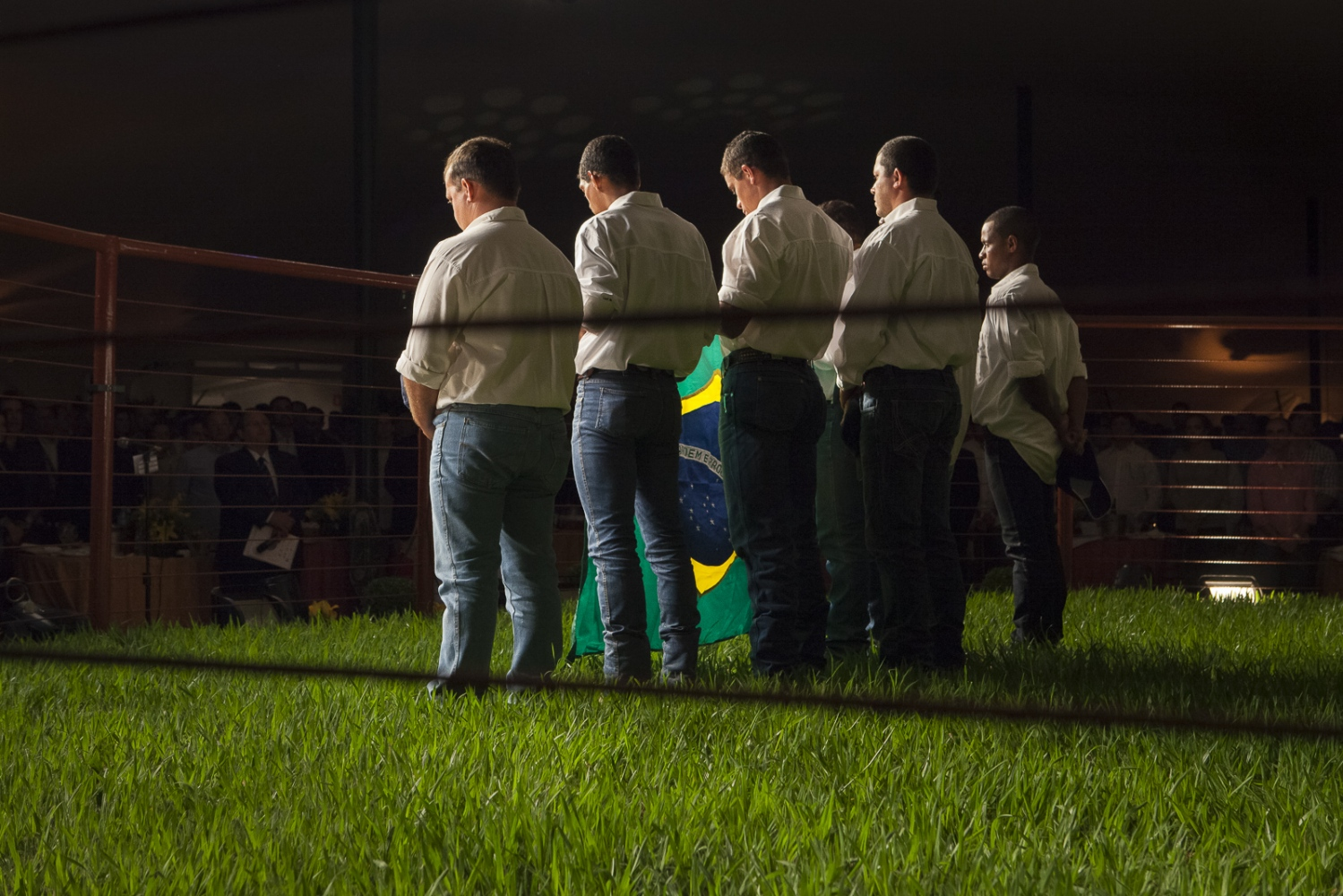In a conservatif and patriotic ambiance, cowboys sing the national hymn in a private luxury cattle's auction opening during ExpoZebu Cattle Fair.  Uberaba, Brazil, 2013