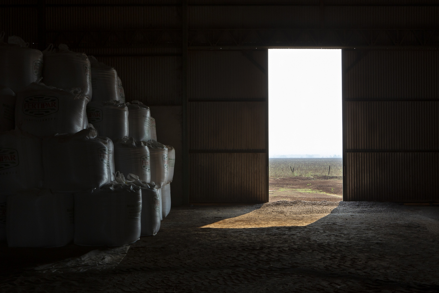 Feed in storage. Soybean meal, corn DDG, cottonseed, ground sorghum, salt and moist corn constitute the cattle feed on this farm. To 30,000 animals, 205 tonnes of feed are served daily. Pontes e Lacerda, Brazil, 2015