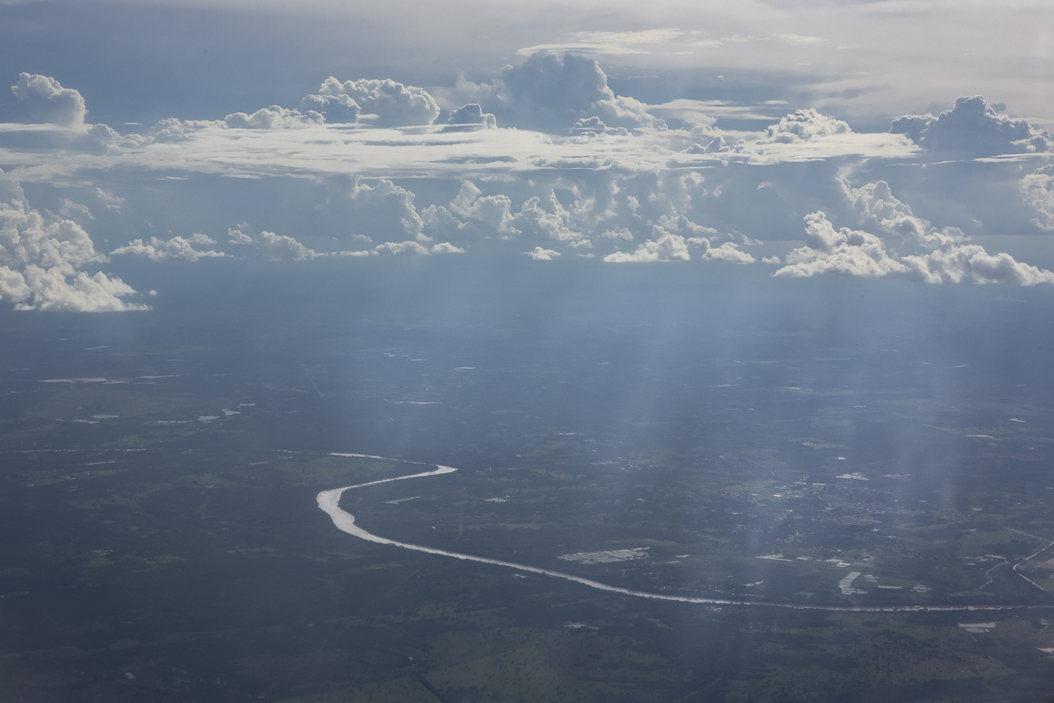 Aerial view of the Cuiaba river that, with its almost 1000 km of extension crosses the capital of Mato Grosso State (of the same name) and connects the region with the south center of the country. After the official statistics of Brazilian Government, Mato Grosso has 40% of its land occupied by extensive beef cattle and is the largest region in soy production of the country. Over Cuiaba river, Mato Grosso, Brazil, 2017