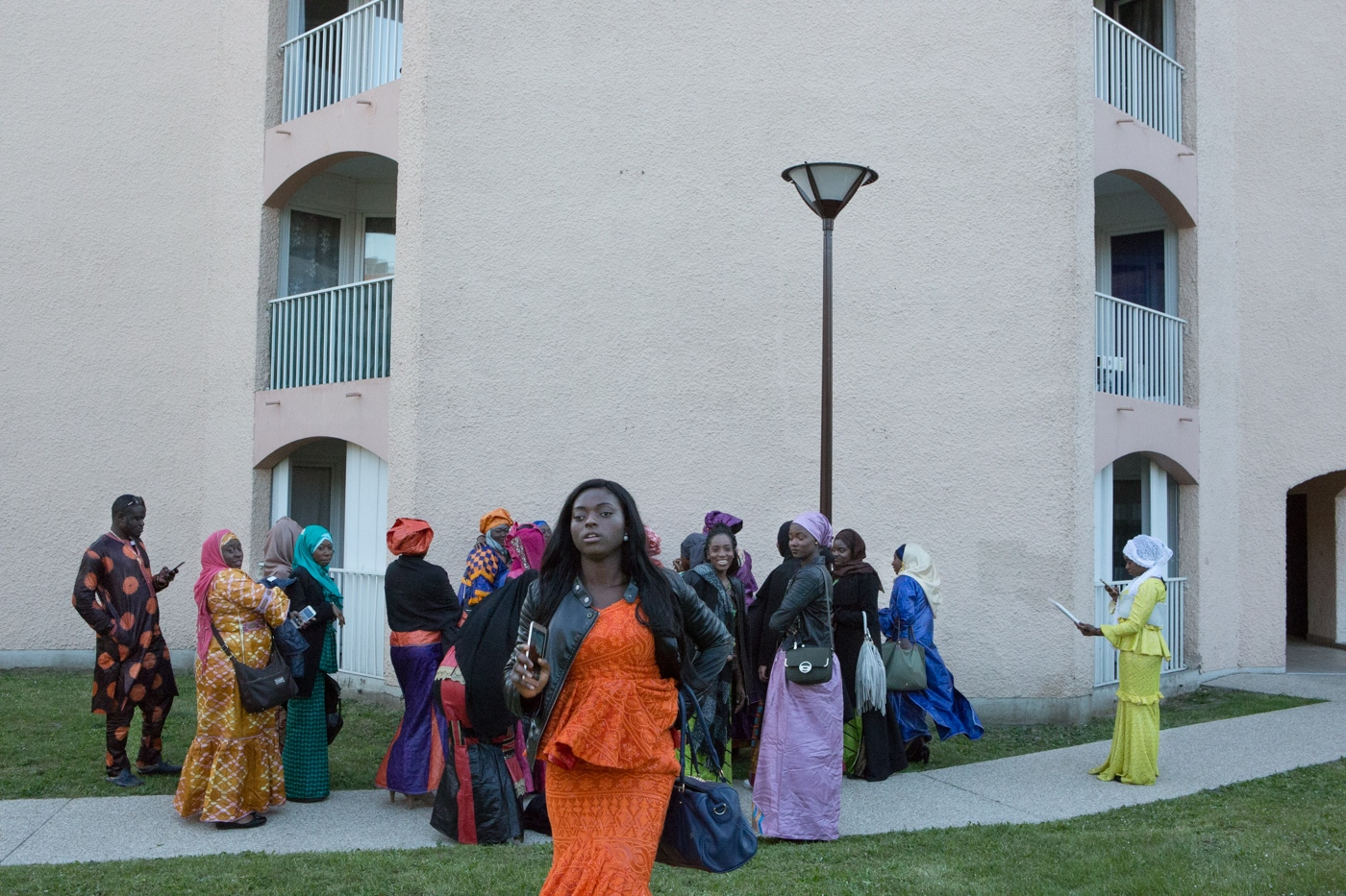 Malian girls celebrating a wedding party at the building yard. Weddings are quite important for what means celebrating a traditional ritual from the parents origin. Each country and each ethnic origin has its own way, music and religious way of celebrating this tradition. Deuil-la-Barre, Ile de France