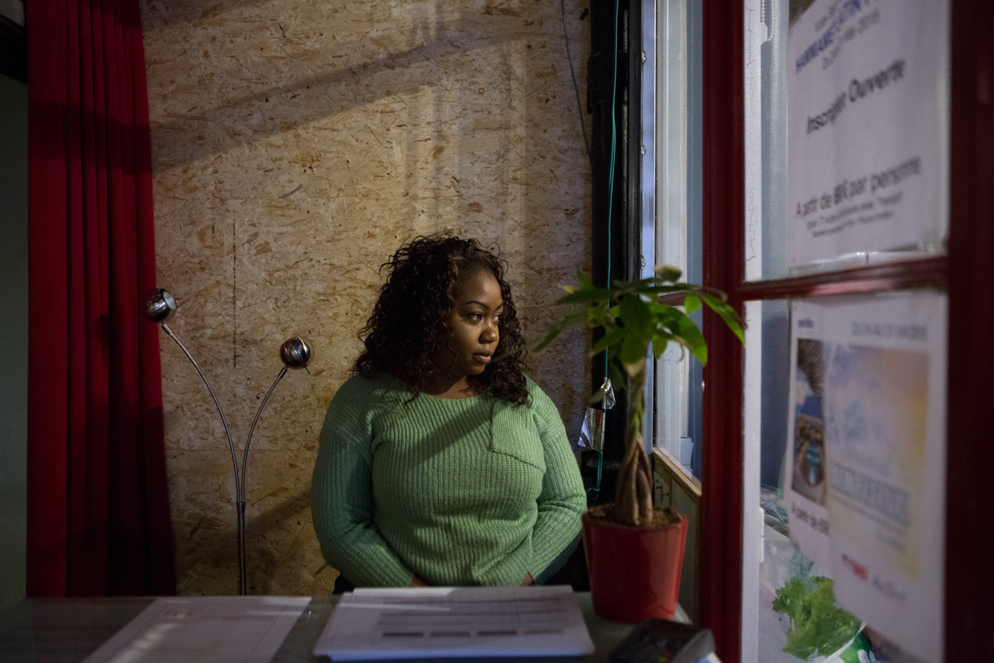 Linda Corinne Saul, stares at the window in the dance school she works as a hostess in Paris 2015