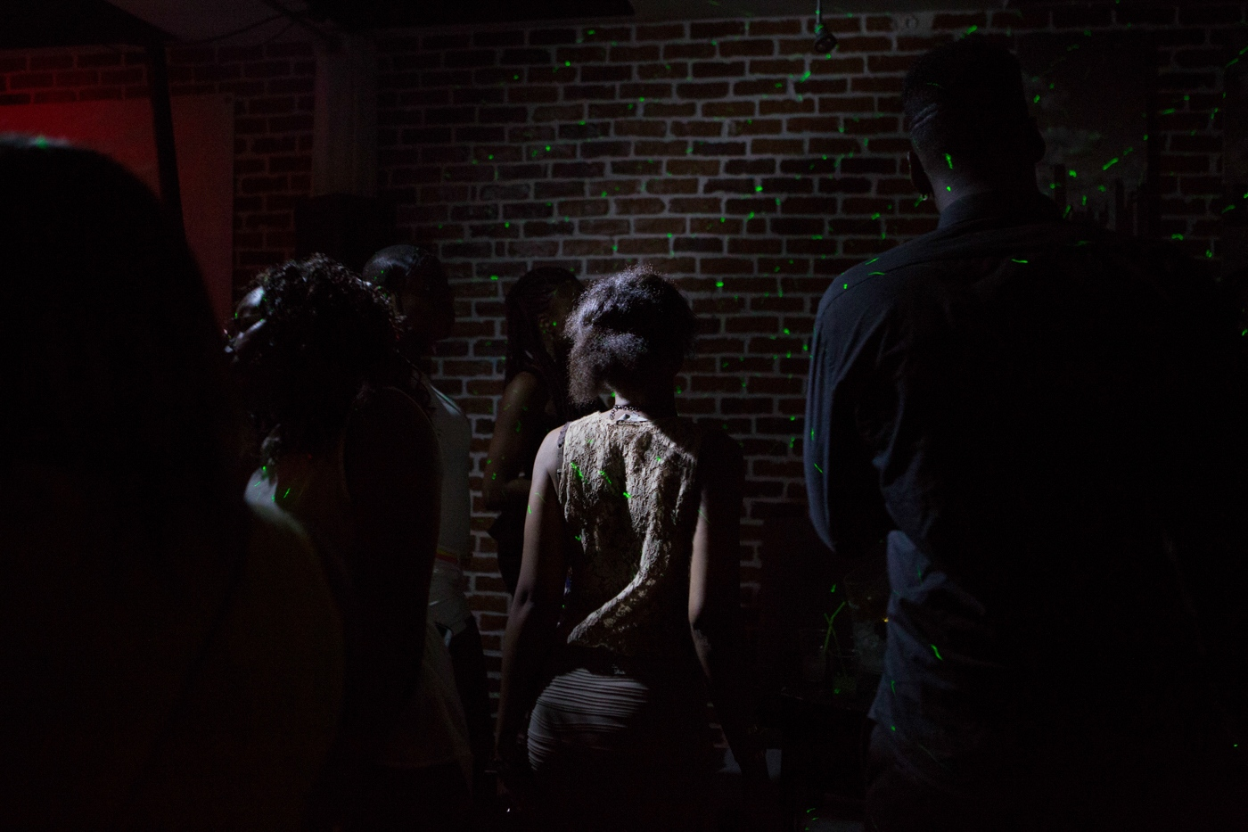 Girl dances at Blend Party a Community Party for the First Generation of Afro-French citizens. Their immigrated parents kept activities around their origin, not mixing among countries. The First Generation, recognising as an Afro unity in France, creates meetings of mixed and continental common origin. Paris, Ile de France, 2015.