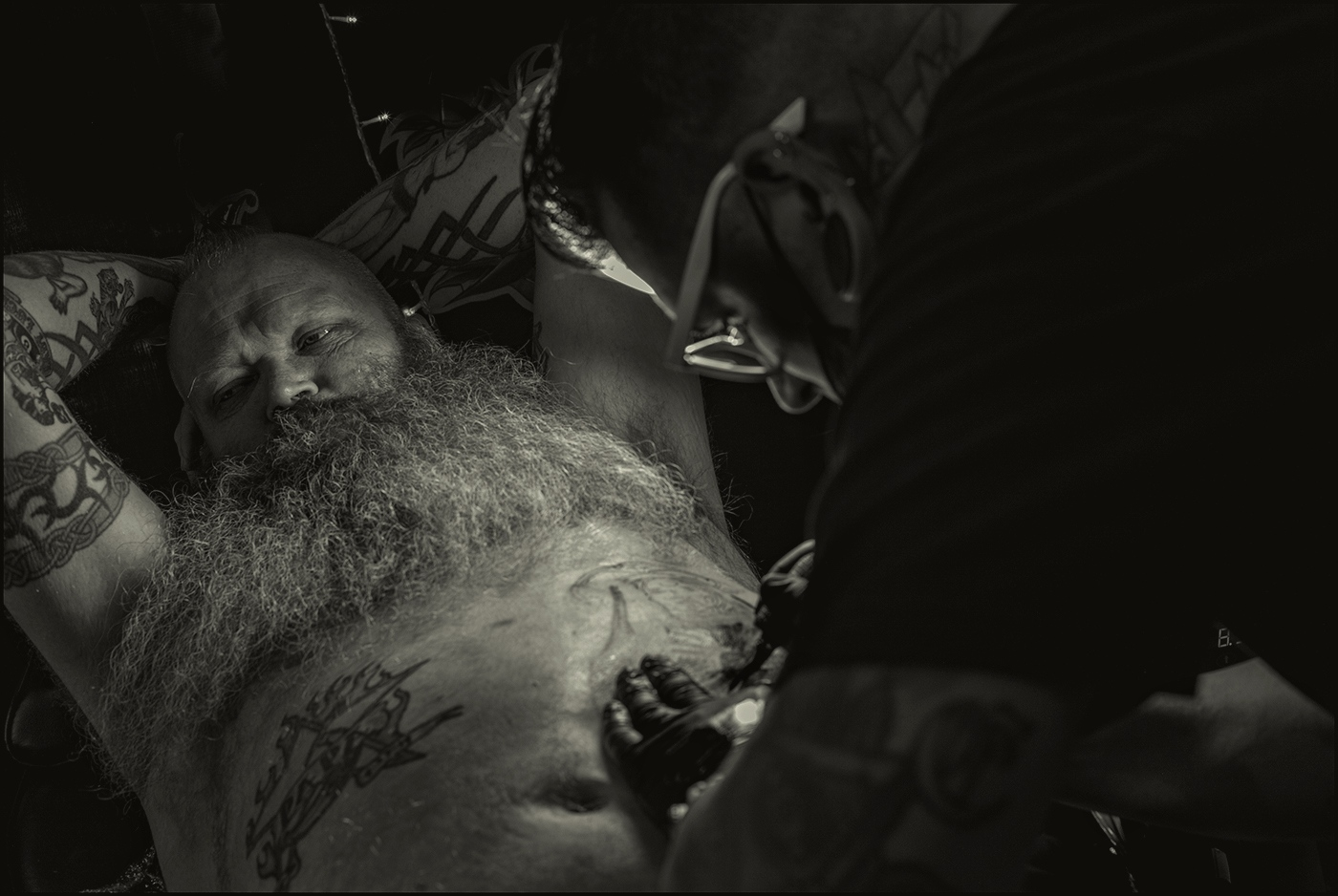 John from Mesa, Arizona having a tattoo applied. His first tattoo was in 1986. Tattoo Expo, Arizona. March 2019.