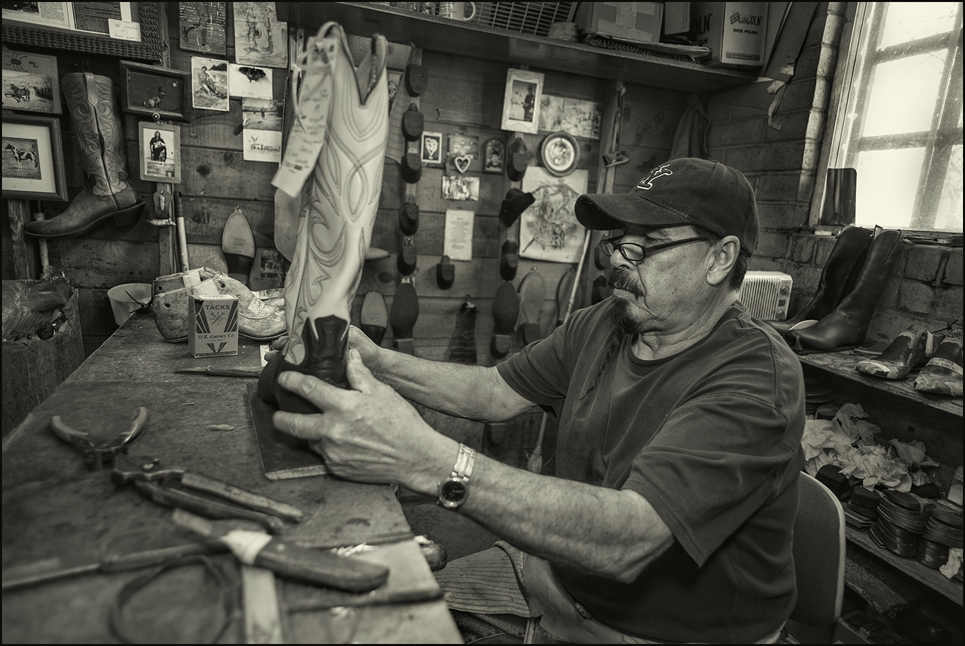 Marcial Gonzales Parra, master craftsman building a custom boot. Paul Bond Boot Company, Nogales, Arizona. Marcial has been making boots for 35-years. March 2019.