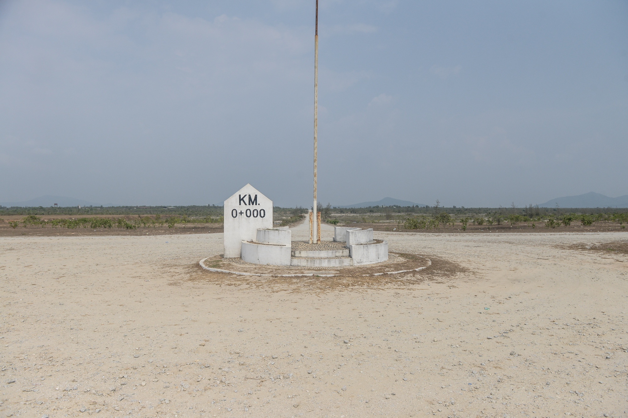 A zero-mile marker at the edge of the Andaman Sea in Dawei to mark the beginning of the road leading from Dawei SEZ to Kanjanaburi province in western Thailand. After completion, the project will consist of a deep-sea port, an oil refinery, a steel mill, fertilizer and petrochemical plants, etcetera and will become one of the largest industrial zones in Southeast Asia. However, the project has been facing much controversy and community opposition both from Myanmar and Thai civil society groups.