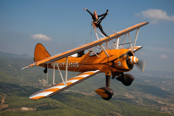 Charlotte Voce, one of the members of the Breitling Wingwalkers team, conducts a training session flying over Castellar del Vallès and its surroundings. Heaven Celebration Parade. Castellar del Vallès, Spain. 01.10.11. Photo Gemma Miralda.