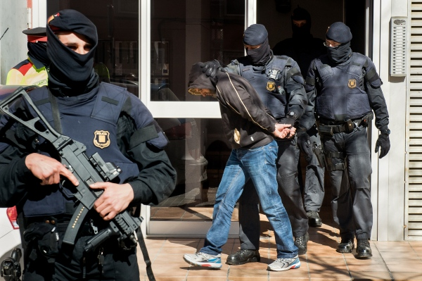 A man is arrested by the Mossos d'Esquadra, national Catalan police, at his home, accused of belonging to jihadism movement. Plini el Vell street, Barri de Can Llonch, Sabadell, Spain. 04/08/15 Photo Gemma Miralda.