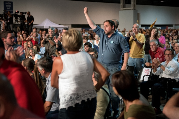 Oriol Junqueras at the moment he goes to the stage to give his political speech in the final meeting of Junts pel Sí. Elections in the Parliament of Catalonia. Fair Enclosure of La Farga. L'Hospitalet de Llobregat, Spain. Photo Gemma Miralda. 19/09/2015
