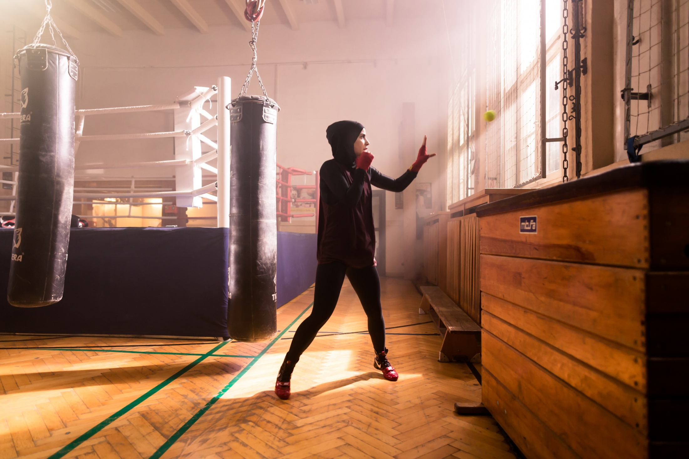 German featherweight boxing champion Zeina Nassar, 21, warms up at her first boxing gym in Berlin Kreuzberg. Berlin, Germany, November 23, 2018.