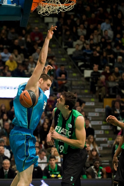 Kosta Perovic from FC Barcelona Regal just scored 2 points against his rival Pere Tomas from Joventut de Badalona, Spain. Endesa League. Day 20.  Municipal Sports Palace of Badalona, Spain 12/02/12 Photo Gemma Miralda.