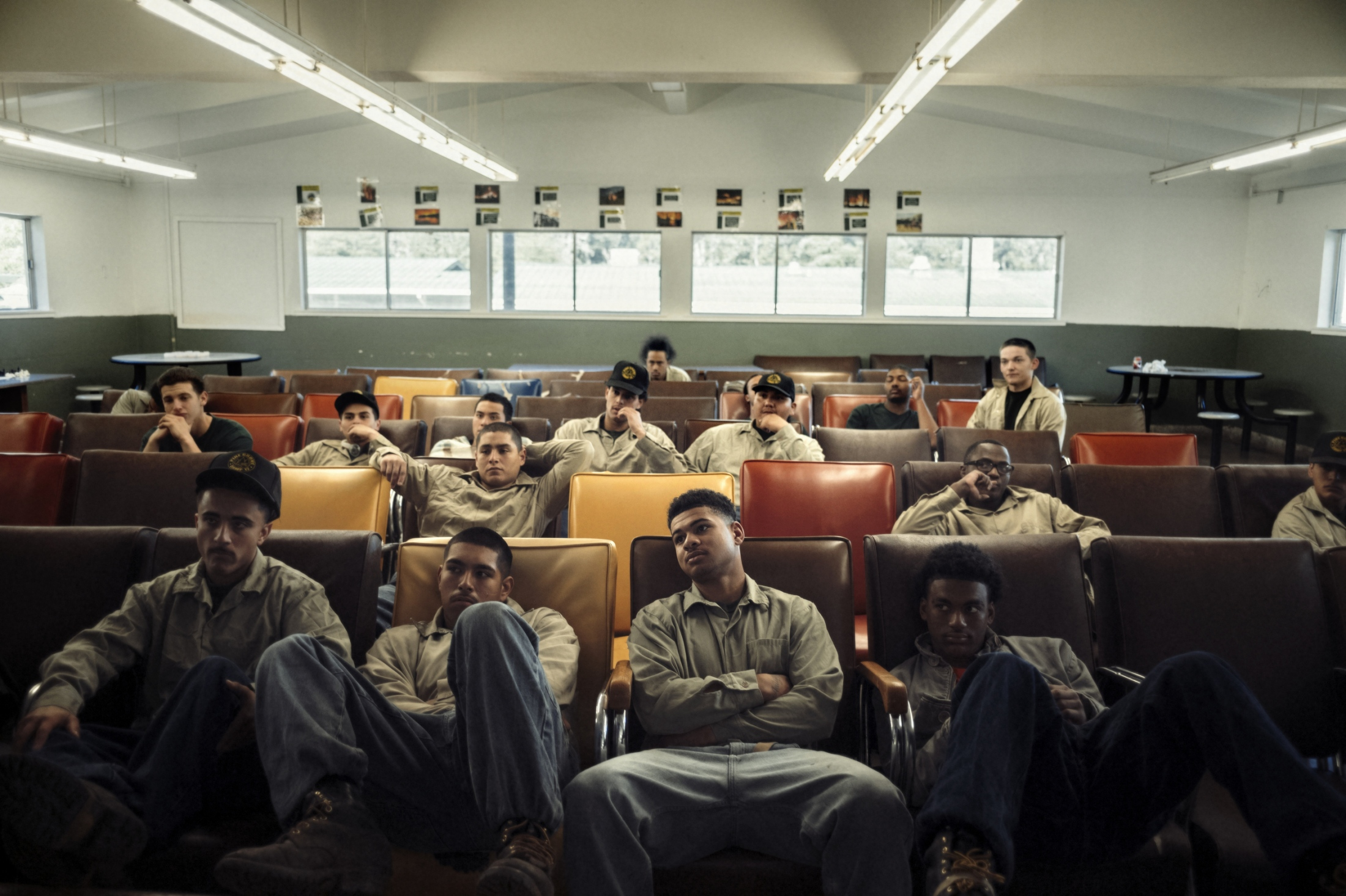 "The few remaining Inmates at Pine Grove sit for a meeting with staff about plans going forward at the camp, after a large violent riot broke out between different groups at the camp.  Though rare at Pine Grove, tensions can rise to a boiling point leading to violent confrontation.  Prior to the riot, the facility had approximately 90 inmates, all but those in the photograph were ""rolled up"" back to higher level security facilities following the riot and pending review of their involvement in the incident."