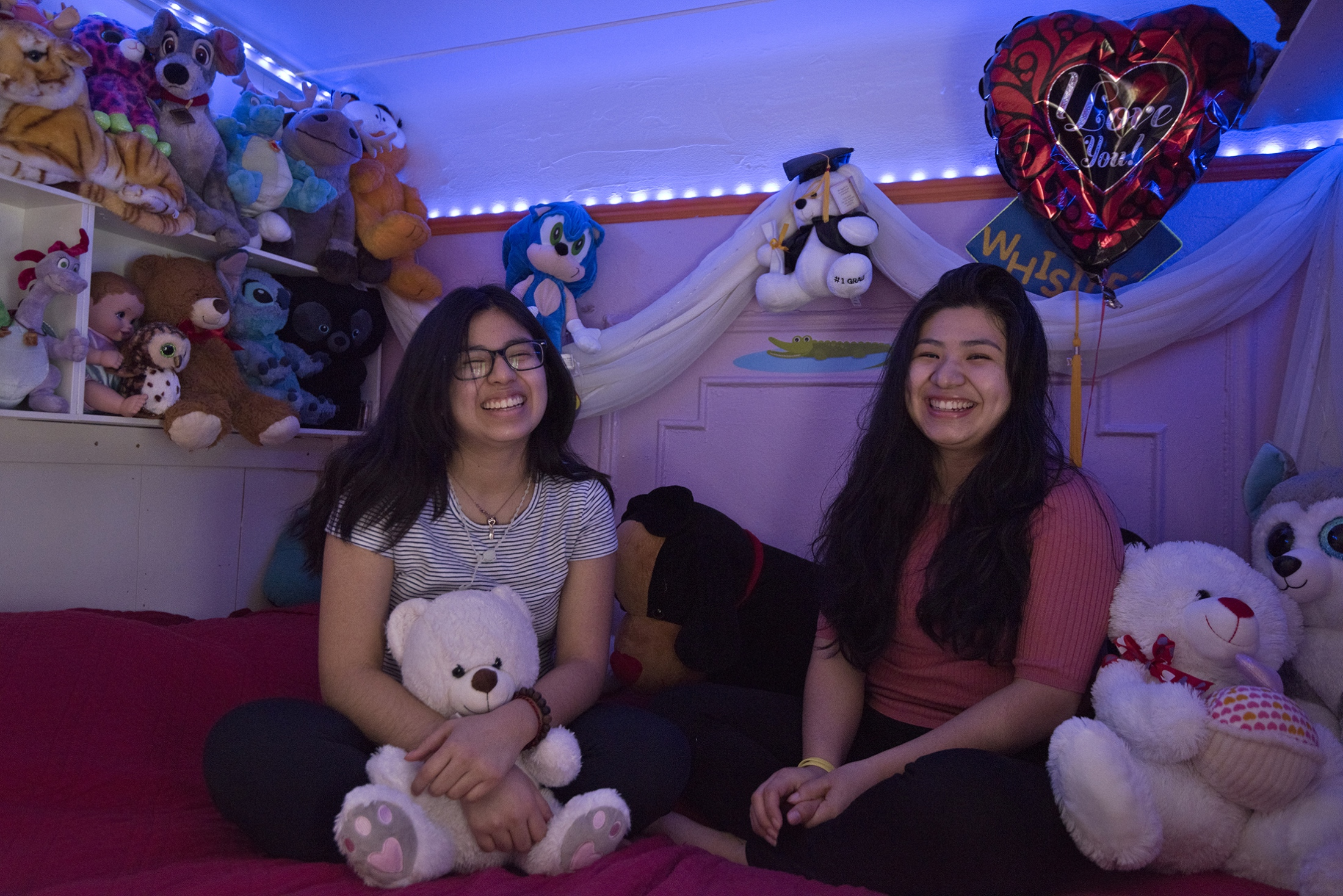 Lizbeth and her sister Adriana in her room