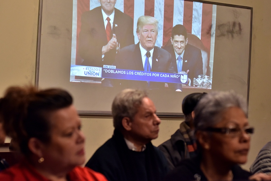 Dreamers, Daca recipients and their supporters turn their backs on U.S President Donald Trump on screen during the State of Union speech at the pro-immigrant headquarters 'Make The Road New York' in Jackson Heights, Queens,on January 30, 2018 in New York City.